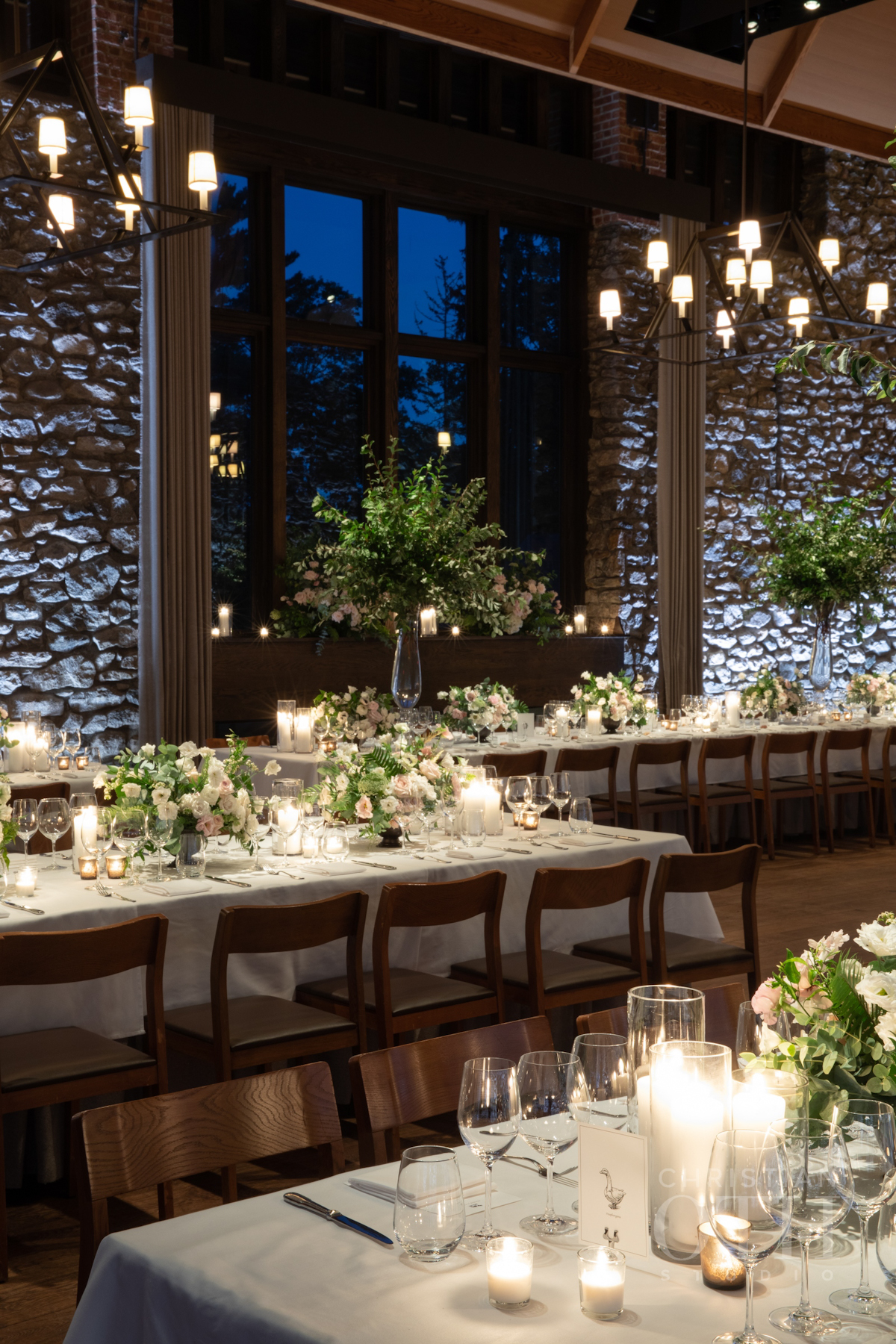 Branch arrangements and lush flowers at Blue Hill at Stone Barns wedding