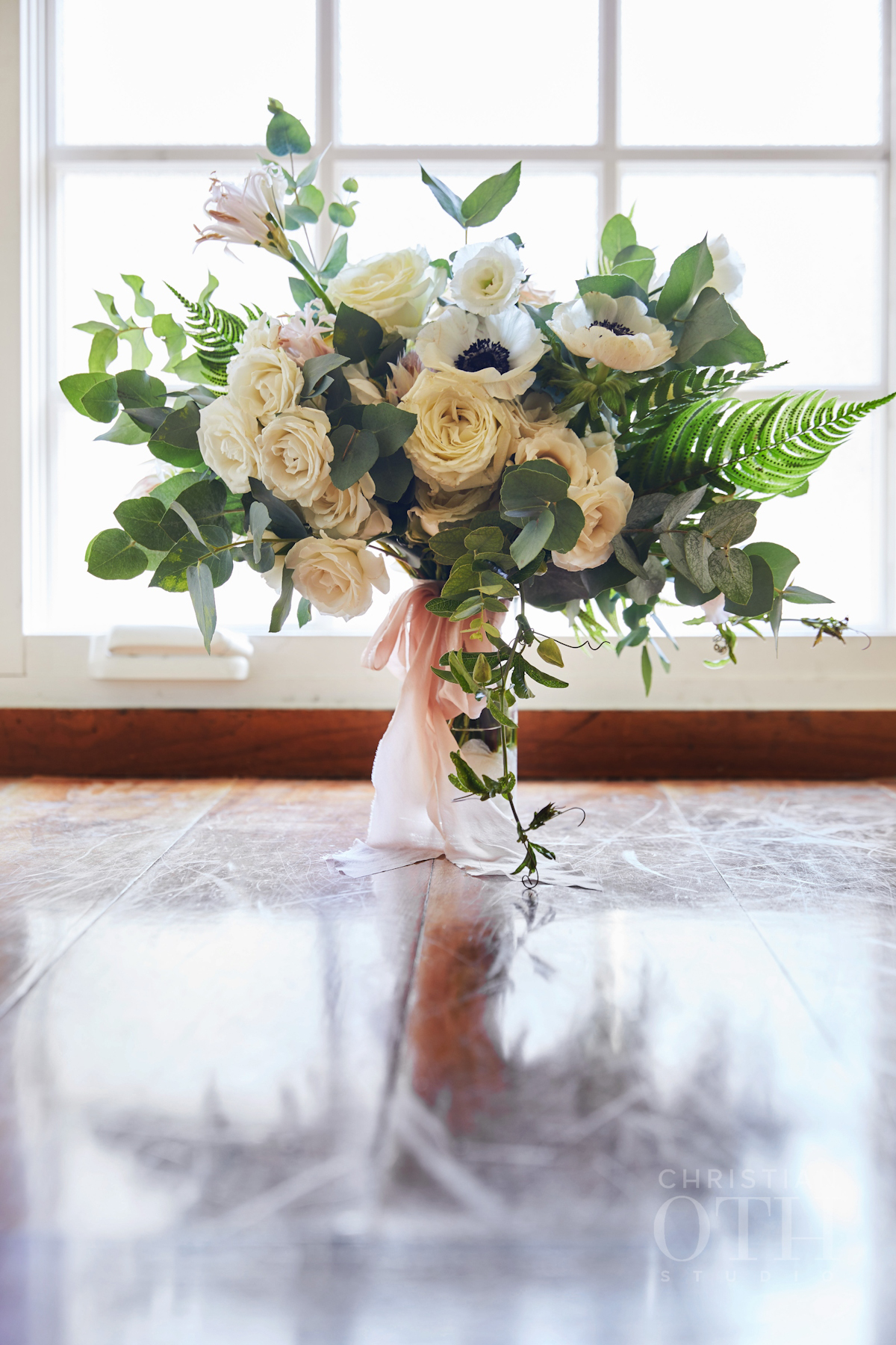 Bridal bouquet with anemonies at Blue Hill wedding