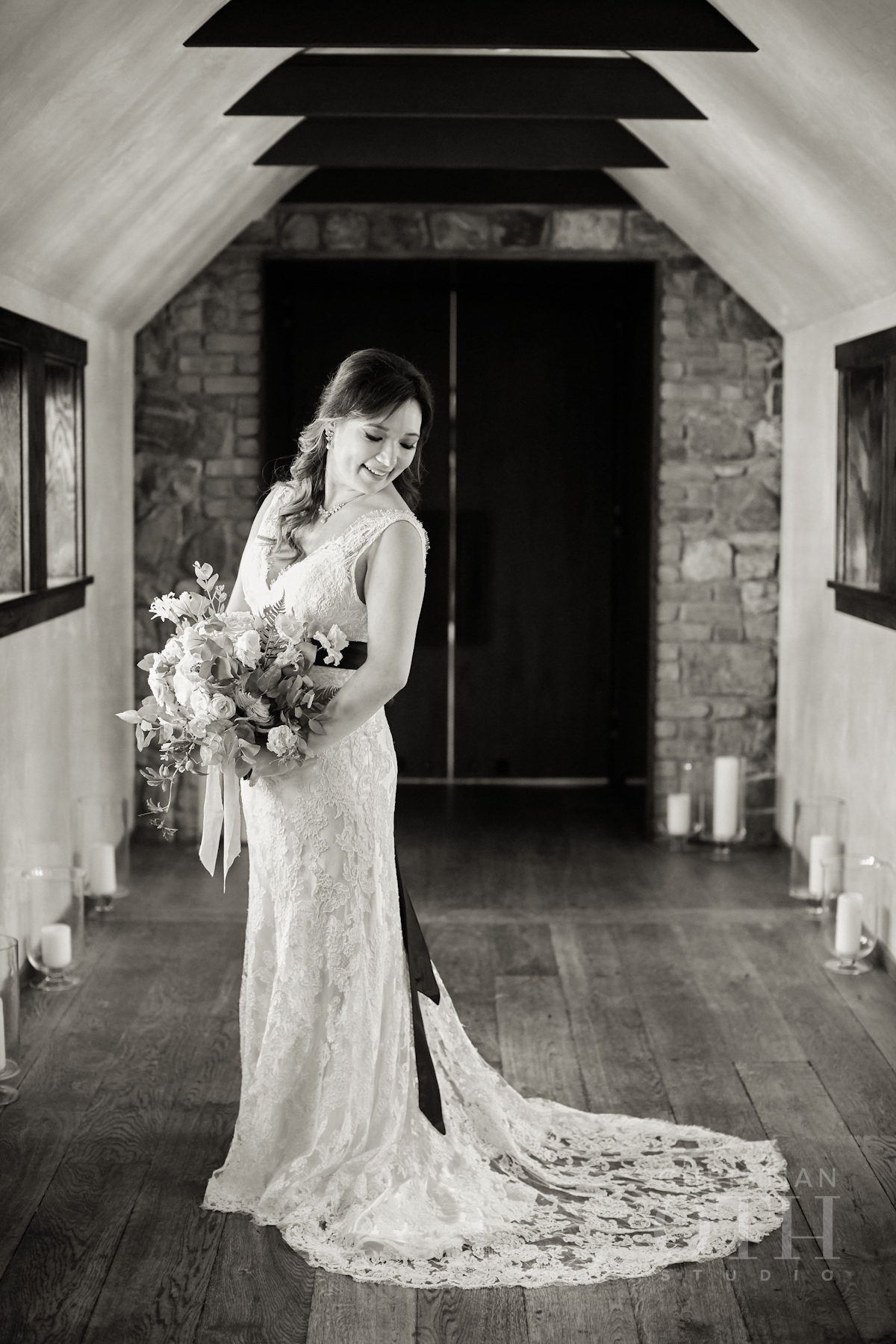 Bride portrait holding bouquet in lace gown at Blue Hill wedding