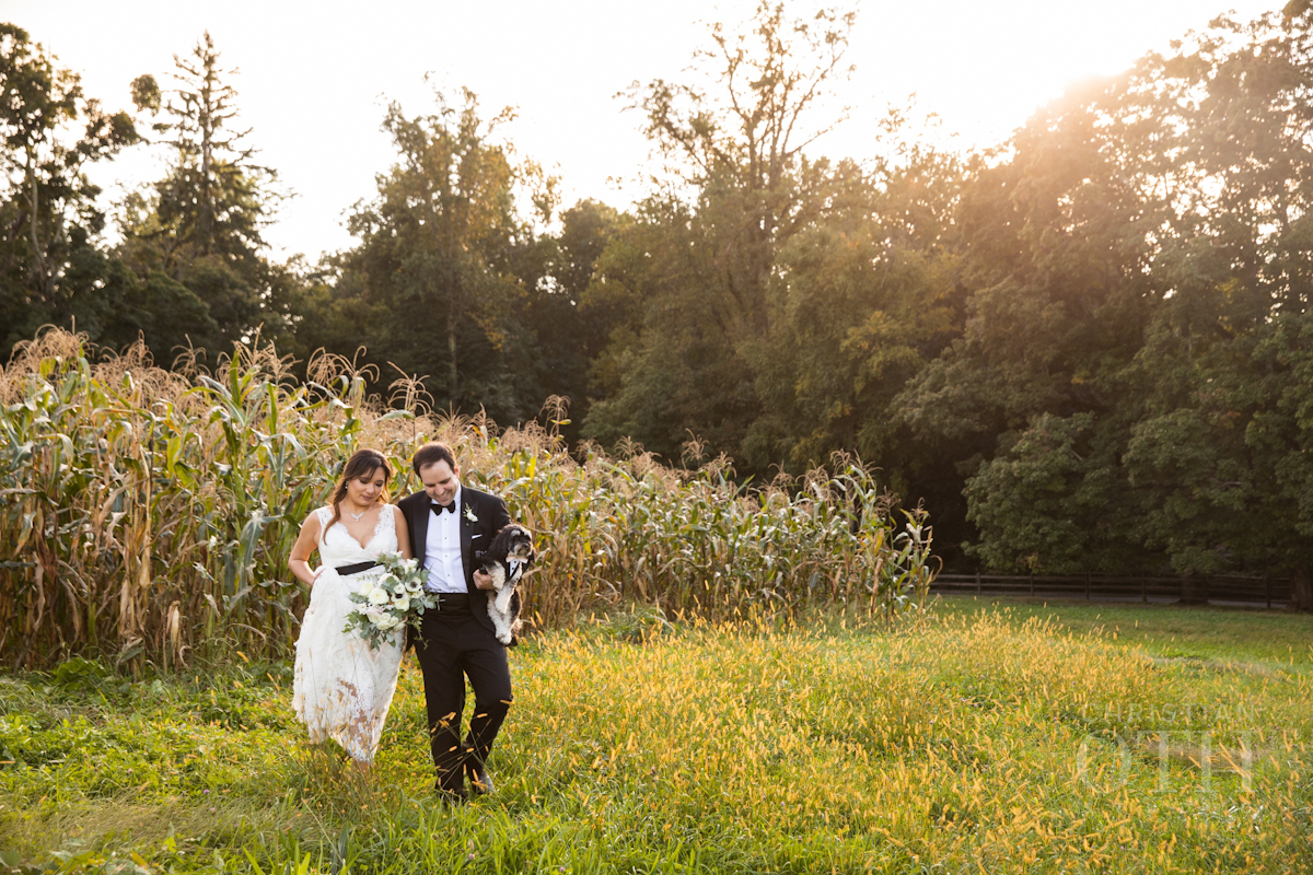 Bride and groom in front of cornfields at Blue Hill at Stone Barns wedding