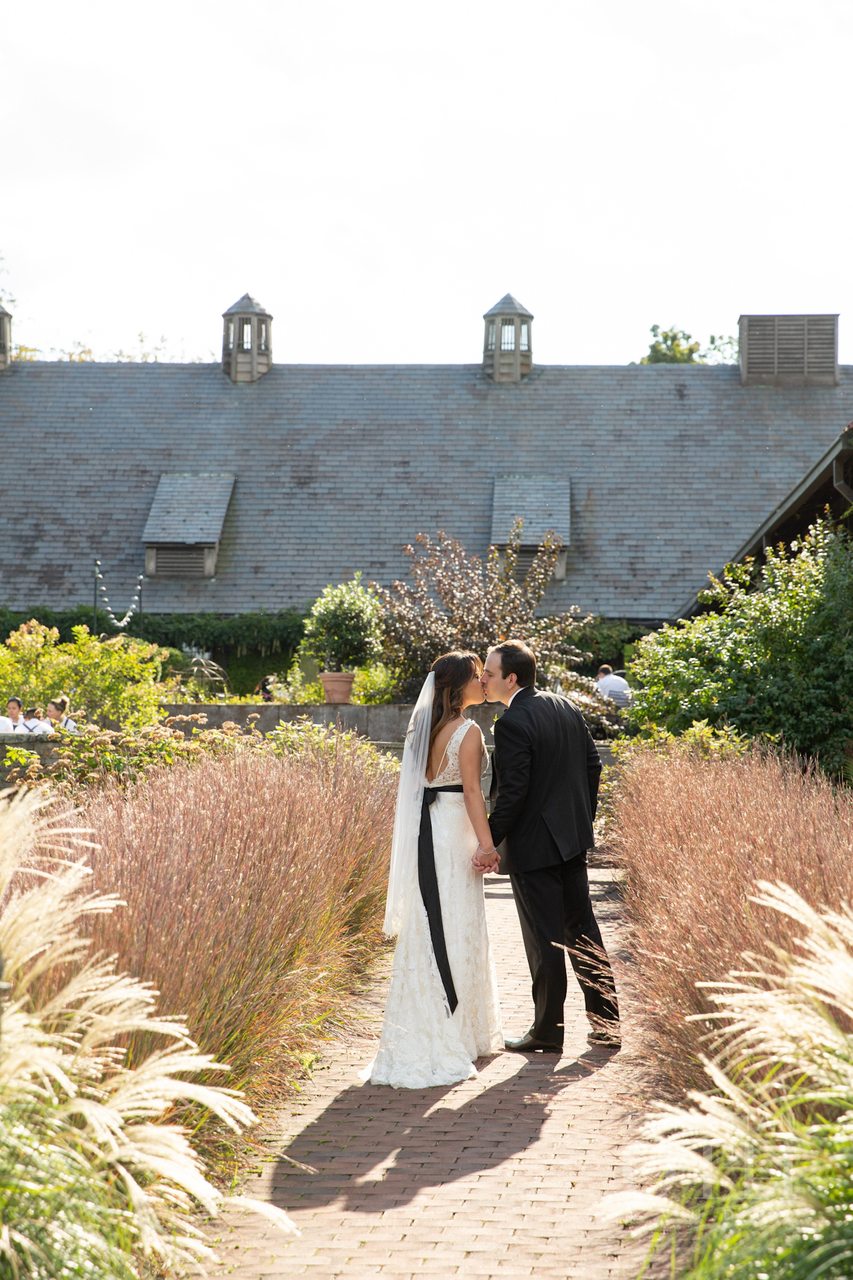 Bride and groom kissing at Blue Hill at Stone Barns wedding
