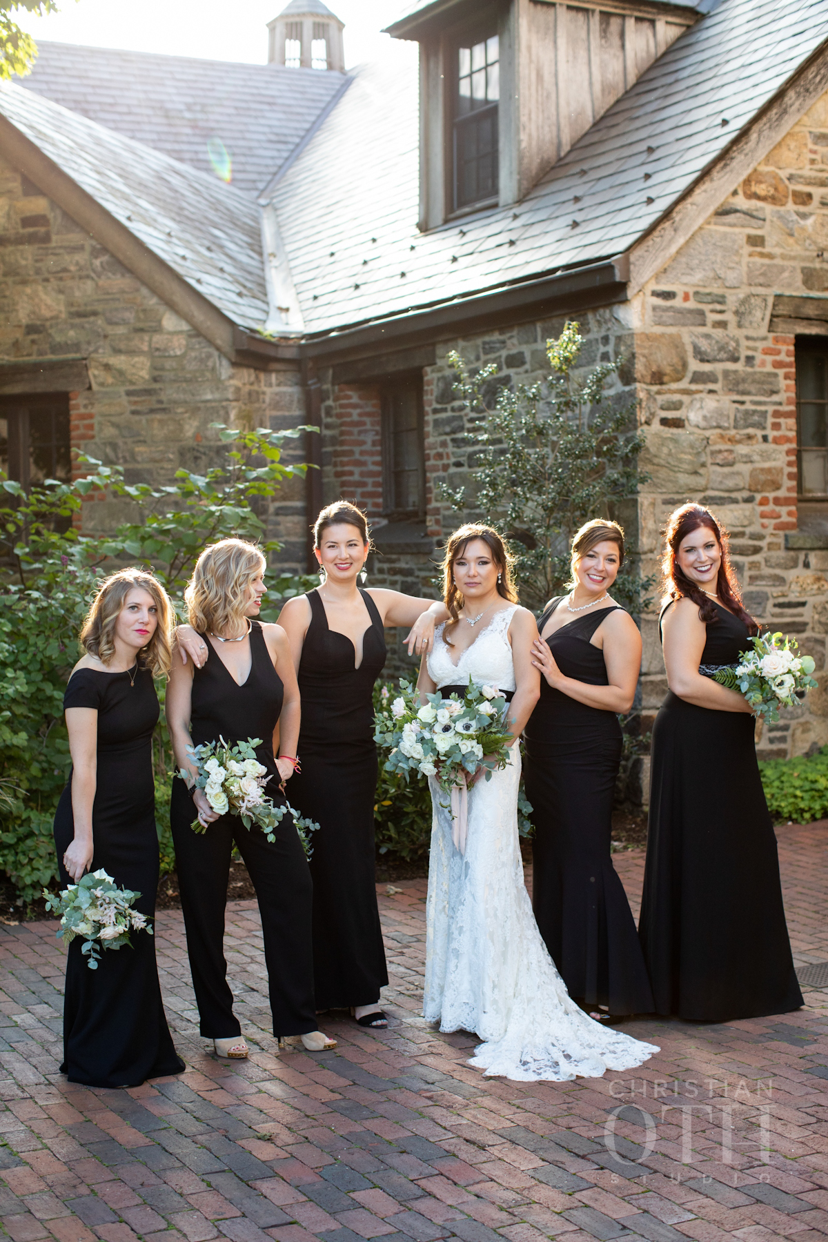 Bride and bridesmaids in black dresses at Blue Hill wedding