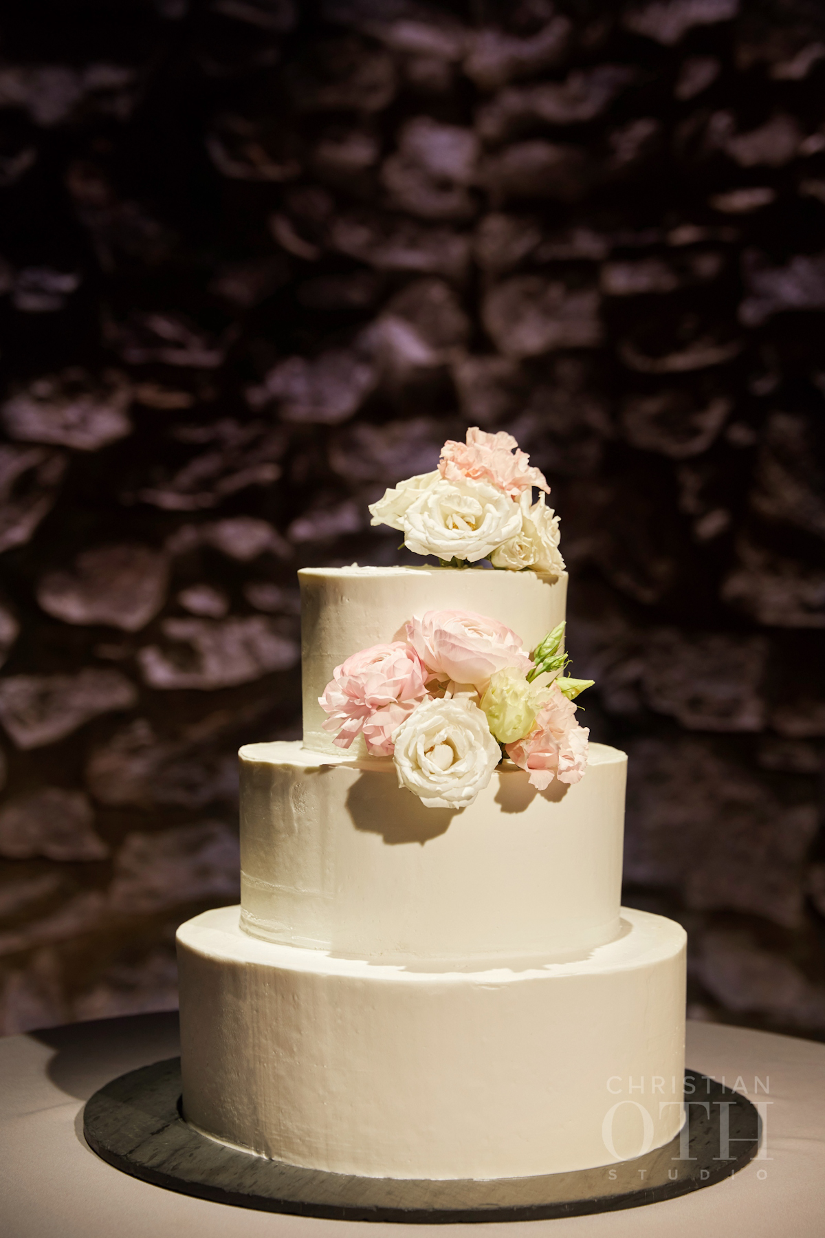 Blue Hill at Stone Barns wedding cake with buttercream and fresh flowers