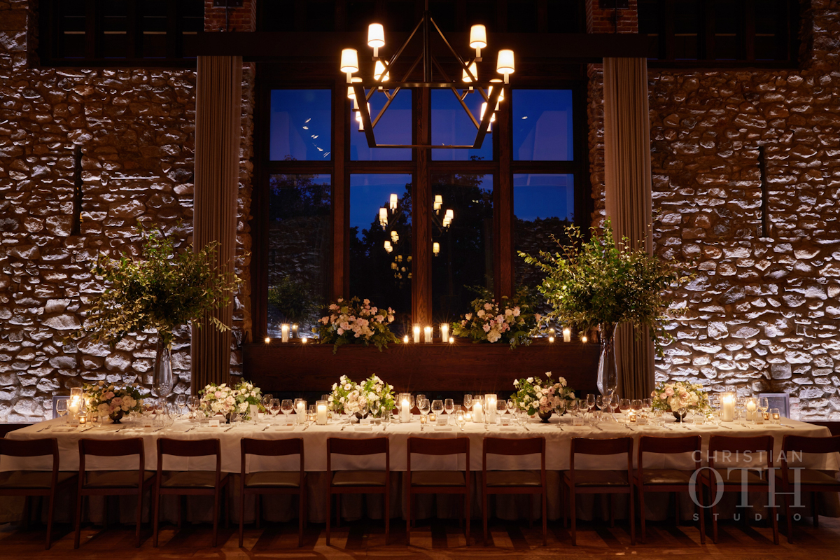 Long table with branches and flowers for Blue Hill at Stone Barns wedding