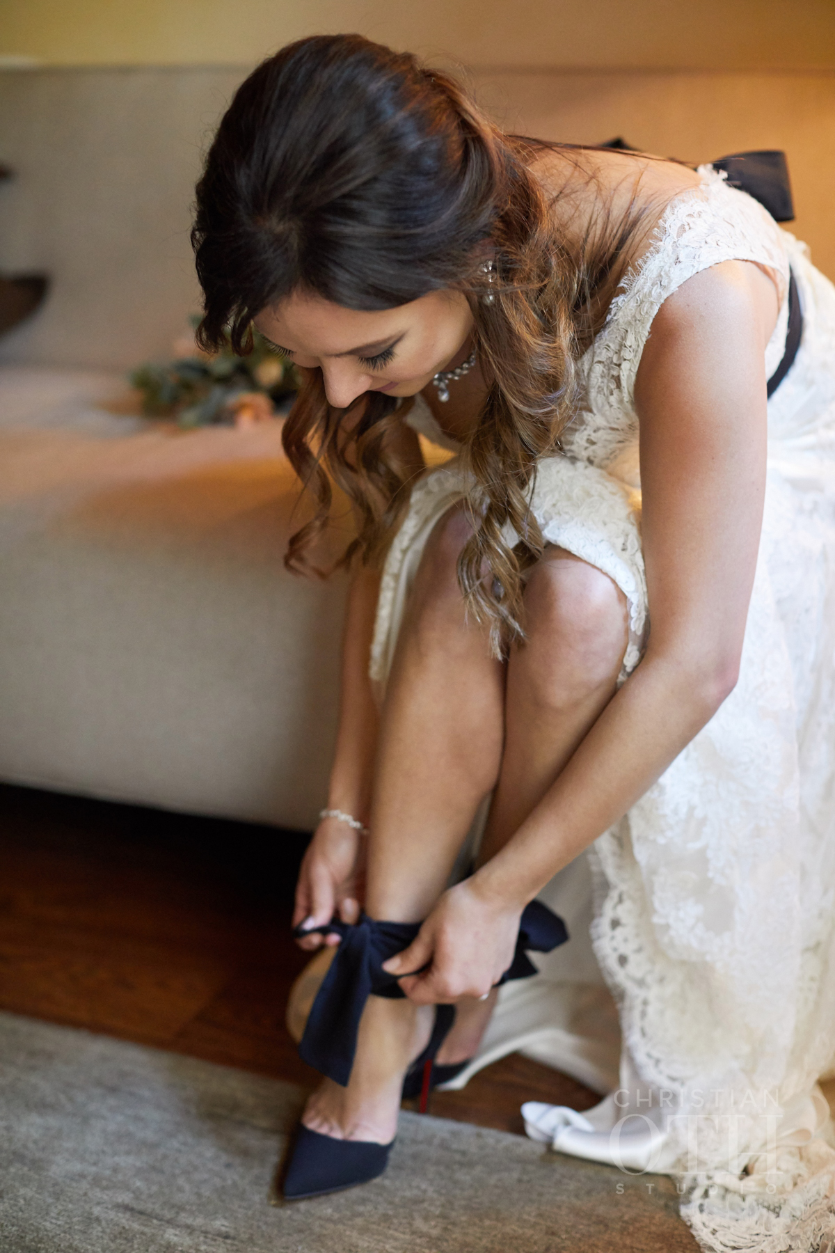 Bride putting on her Louboutin shoes at Blue Hill wedding
