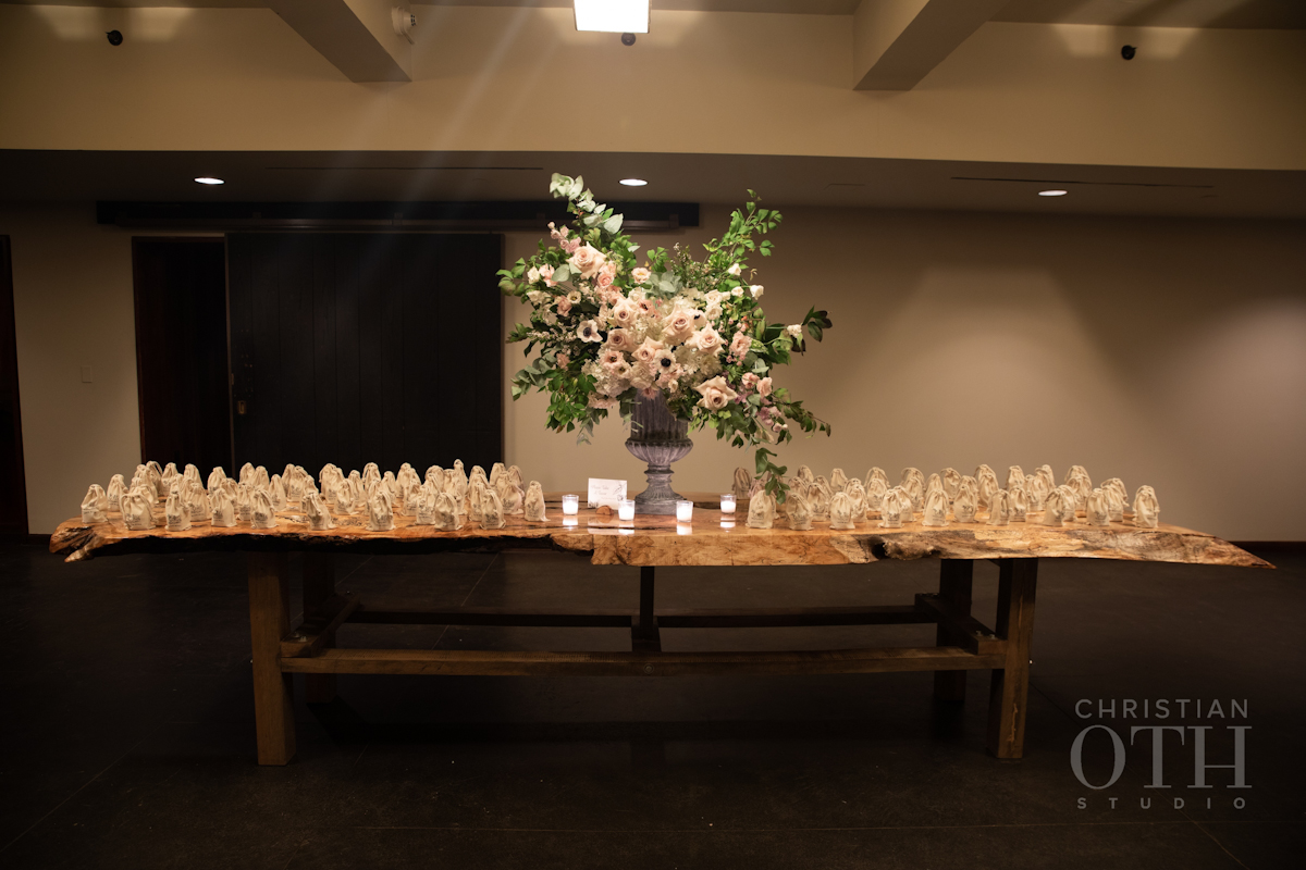 Wedding favours on a long wooden table at Blue Hill at Stone Barns wedding
