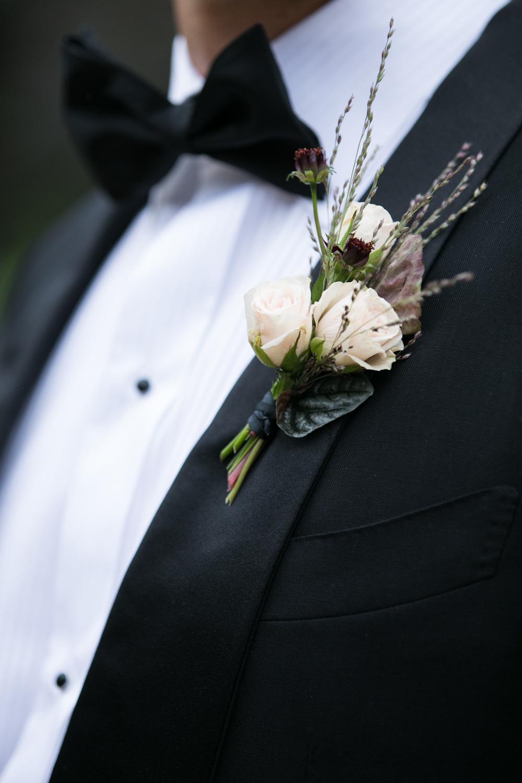 blue-hill-at-stone-barns-wedding-boutonniere-tuxedo.jpg