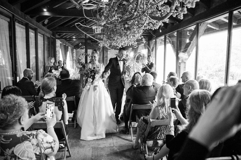 blue-hill-at-stone-barns-wedding-ceremony-loggia-bride-bouquet.jpg