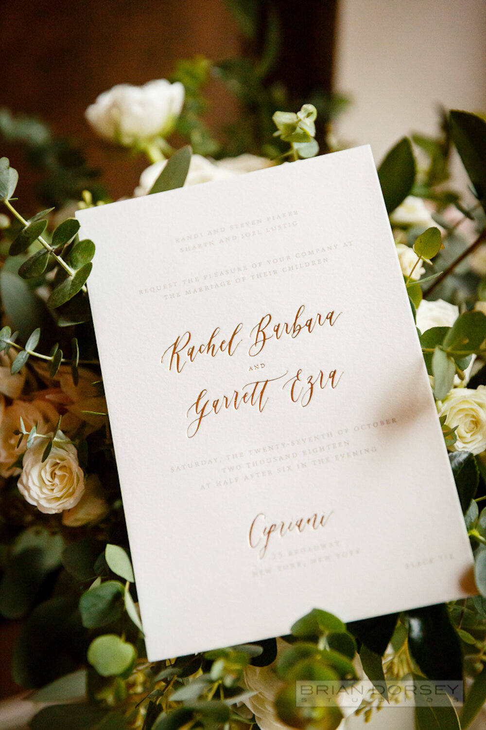Calligraphy and metallic foil stamped wedding invitation