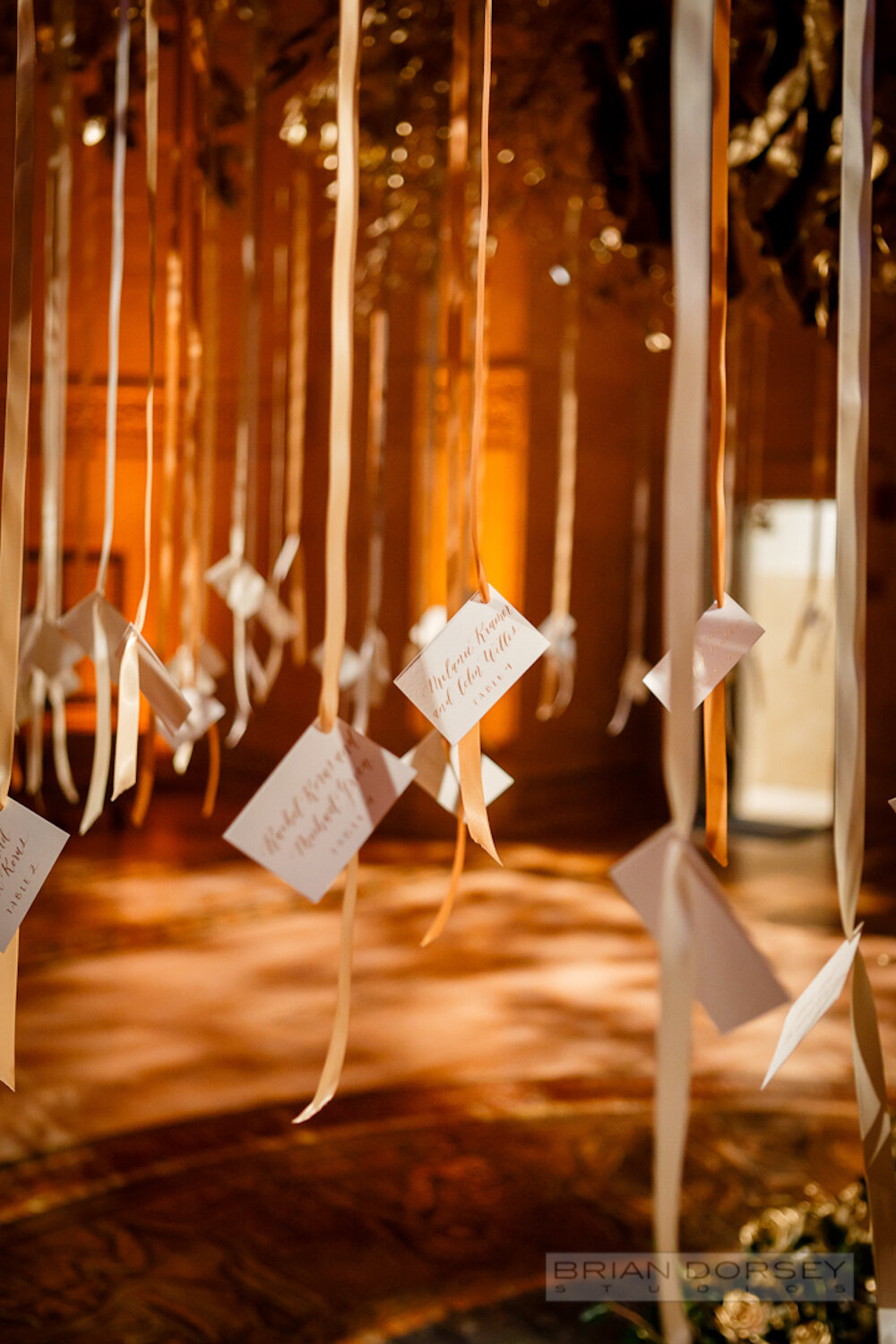 Cipriani wedding hanging escort cards with hand calligraphy