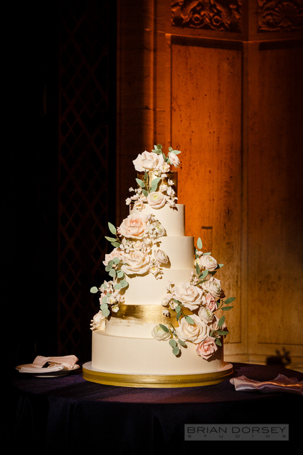Cipriani 25 Broadway Wedding cake with sugar flowers and metallic gold finish
