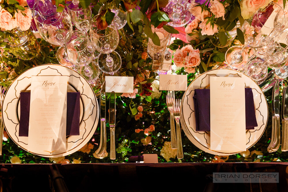 Cipriani 25 Broadway Wedding place setting with chargers and navy napkin