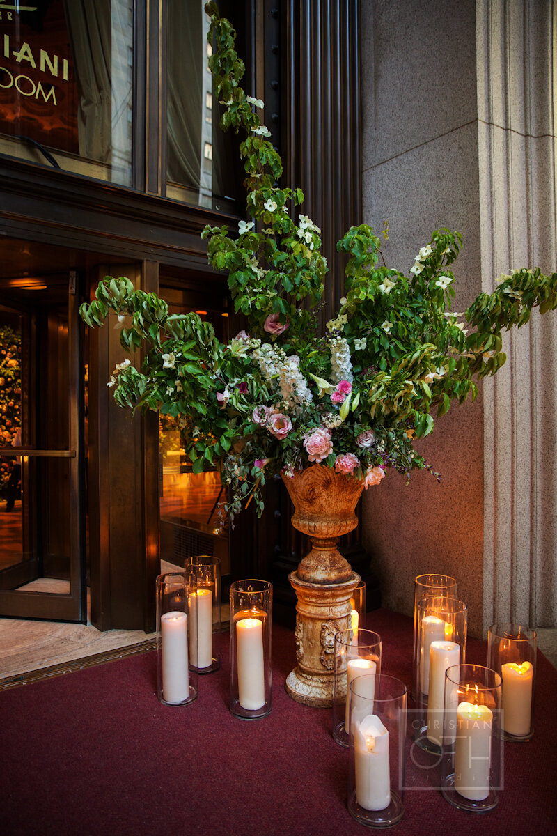 Cipriani Wall Street Wedding flowers and candles at the entrance