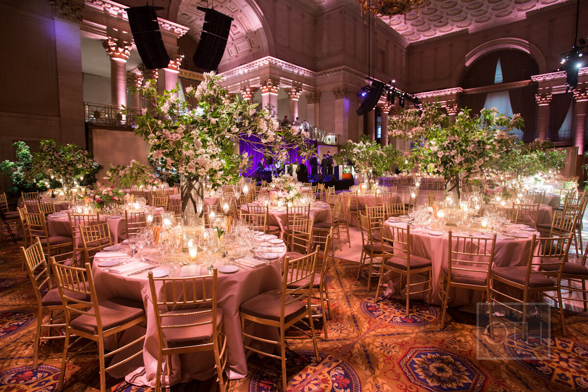 Cipriani Wall Street Wedding tall branch arrangements