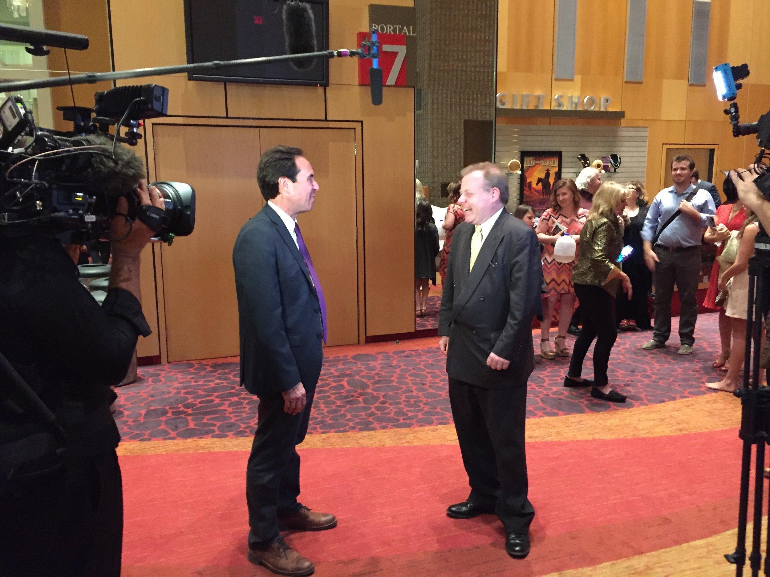 Librettist Steven Mark Kohn talks with an elated Robert Zane Grey after opening night in Phoenix.