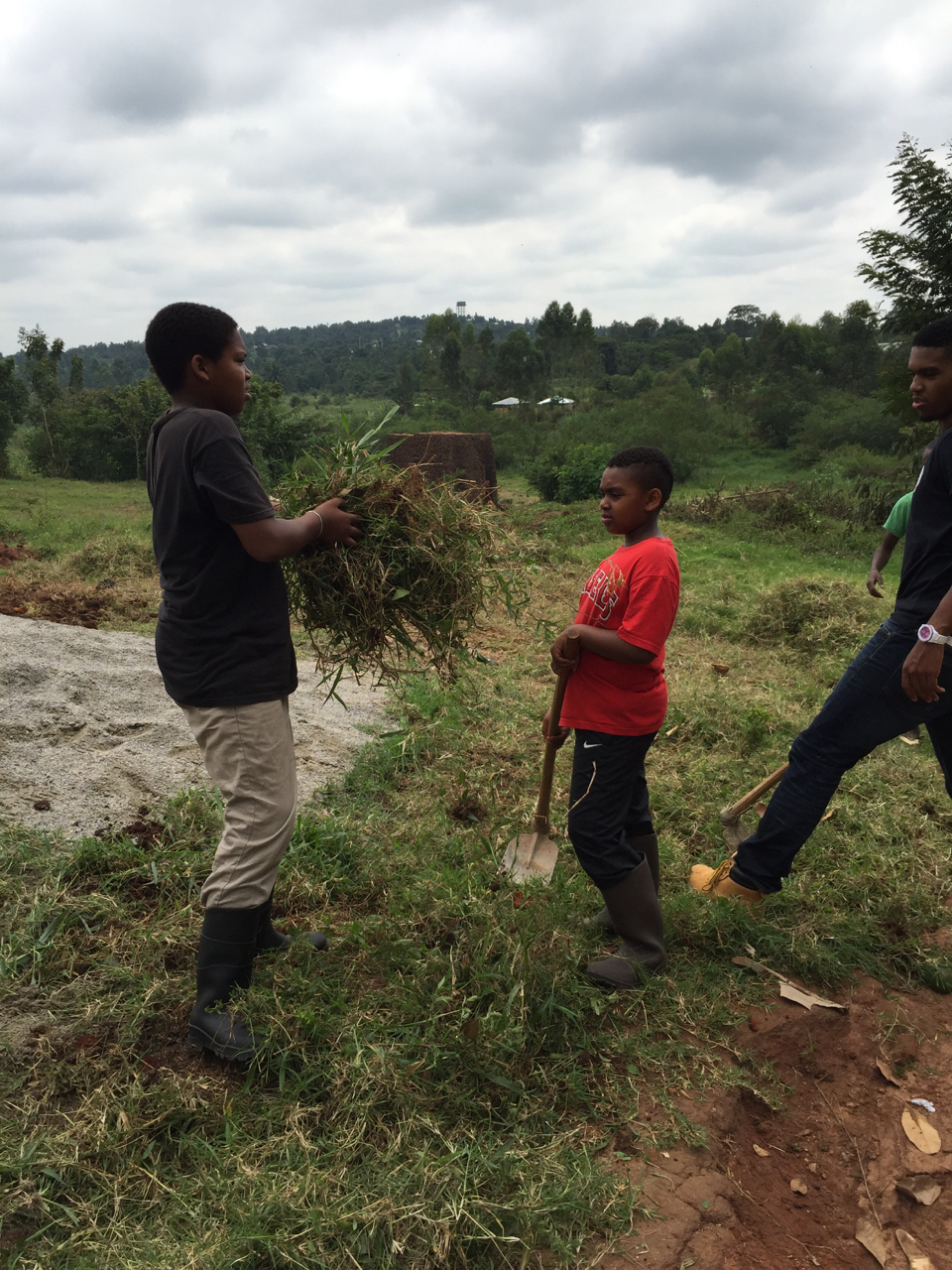 David, Paul, and Joël help clear brush so ground may be leveled