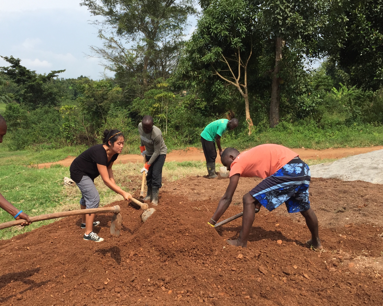 Hannah and JHR residents helping to level ground in front of JHR