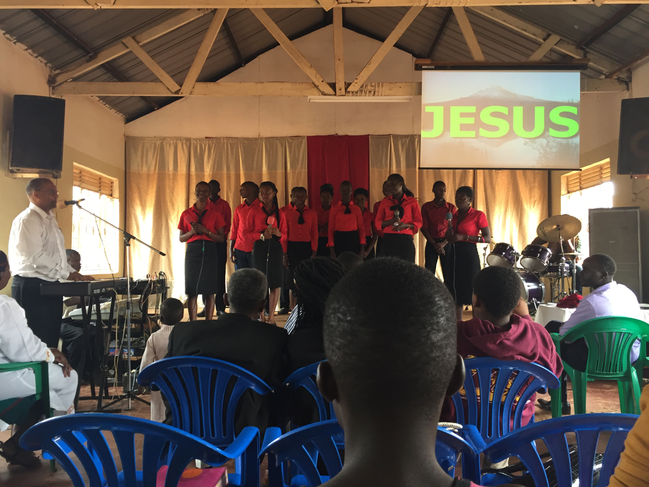 Makinto assisting the choir in leading worship at Bombo Pentecostal Church