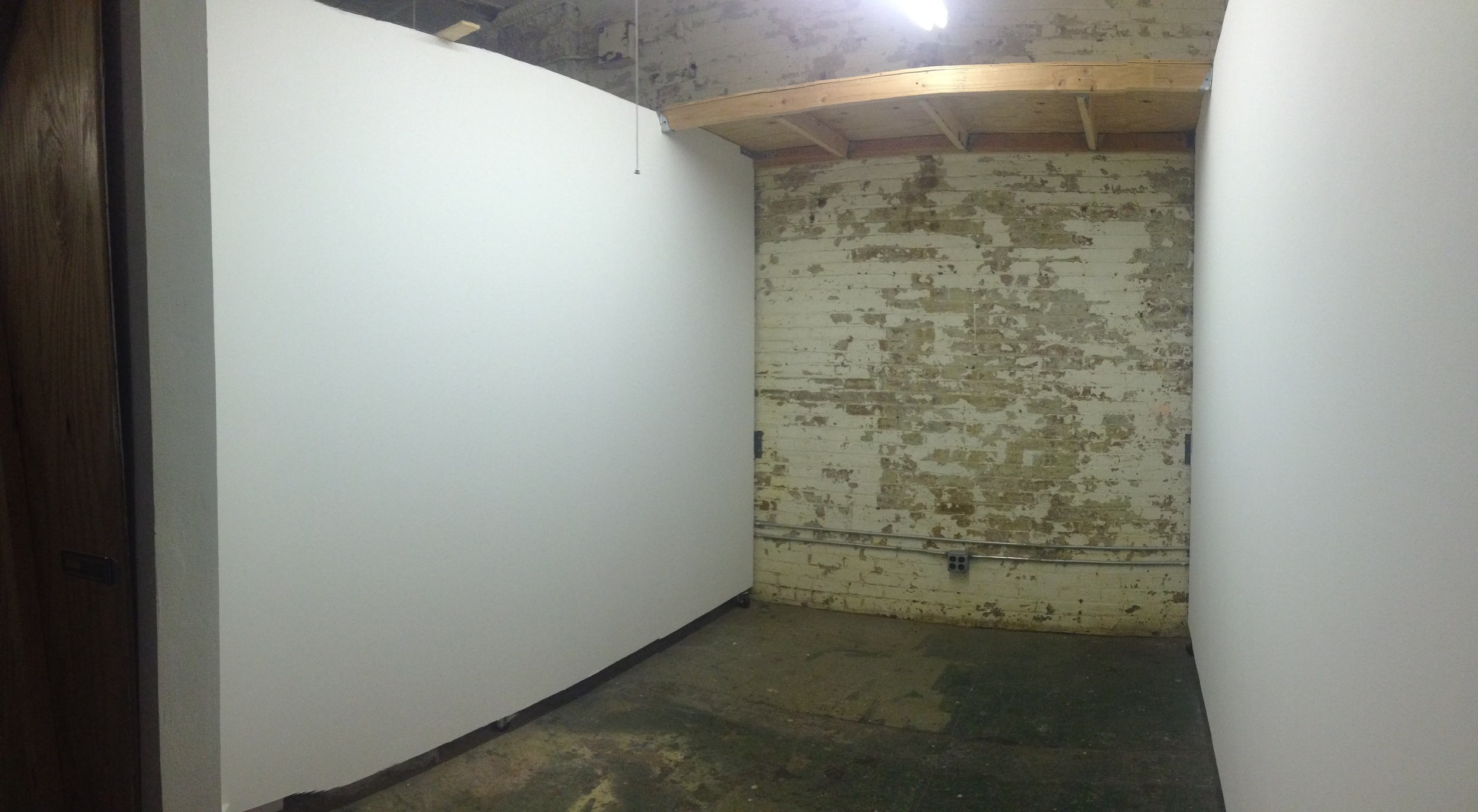 Ground Floor Studio - about 100 square feet, nice white walls reinforced with plywood, and most spaces have a wide shelf.