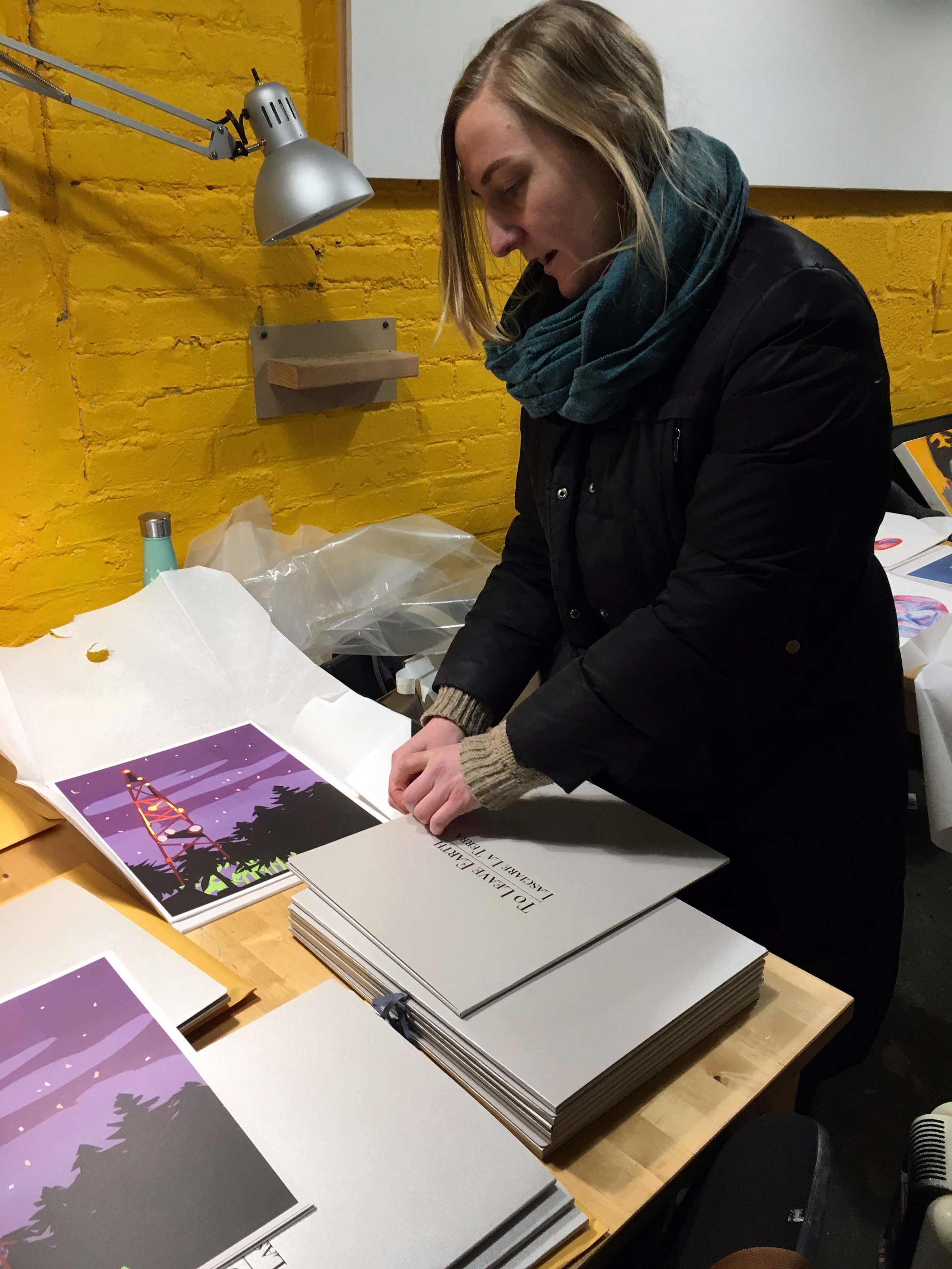 Master printer Kate Kosek preparing folios made by  Small Editions, Brooklyn