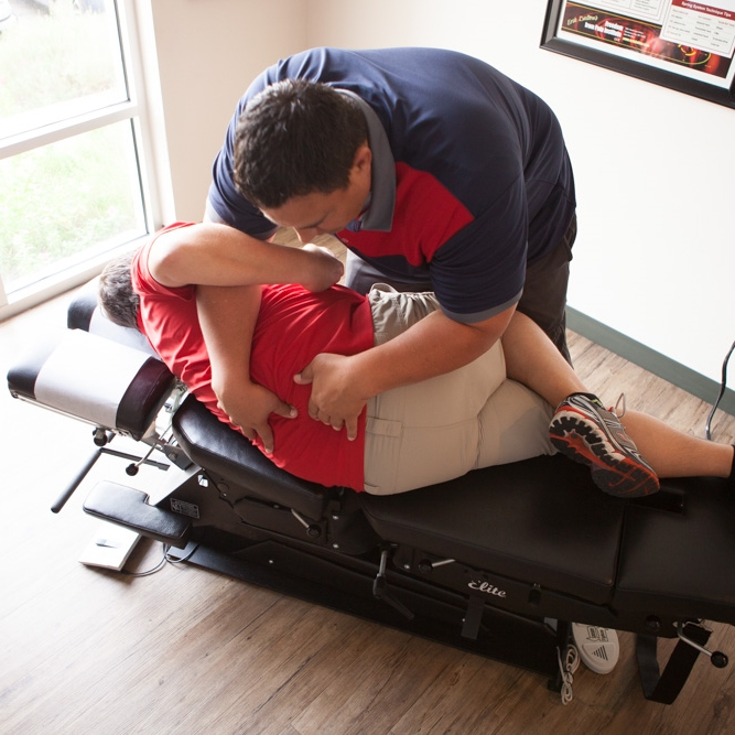 chiropractor performing an adjustment