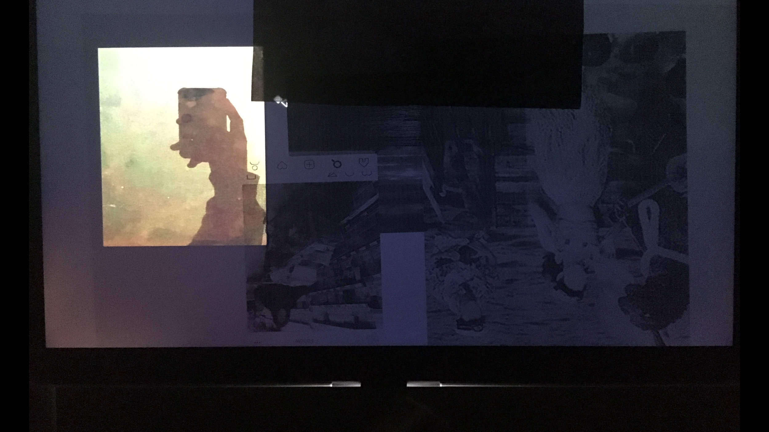 Screen Still #29: Reflections , 2018. Digital photograph, found images, paper, and glass on digital screen. 16:9, dimensions variable.