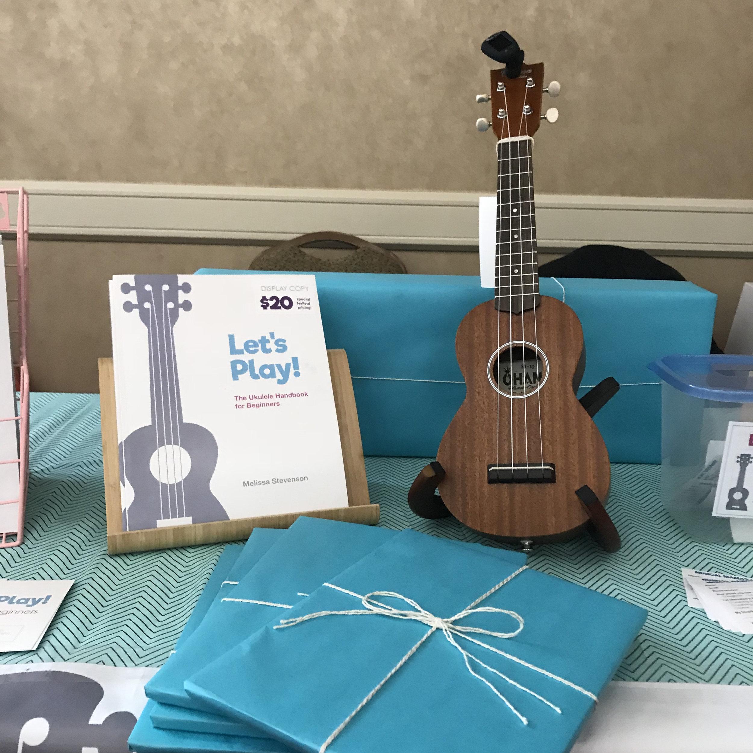 Gift-wrapped books and Ohana ukulele