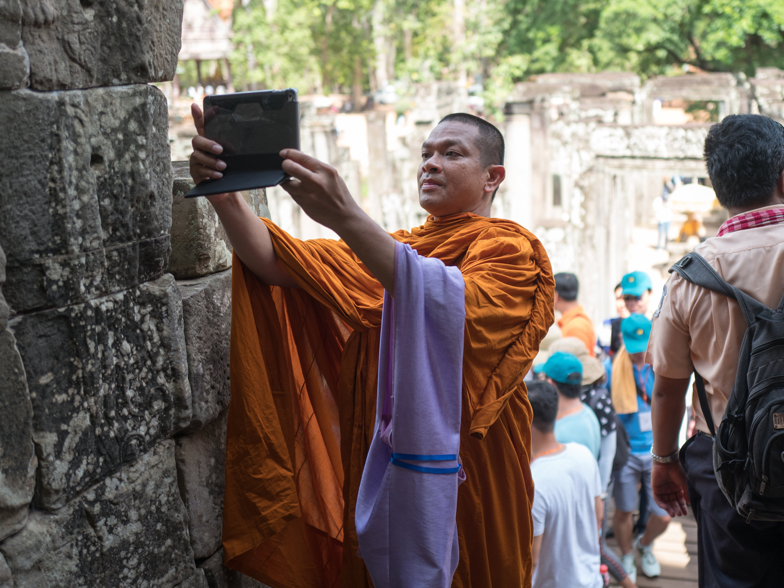 Siem Reap // Bayon - Even the monks are doing it.