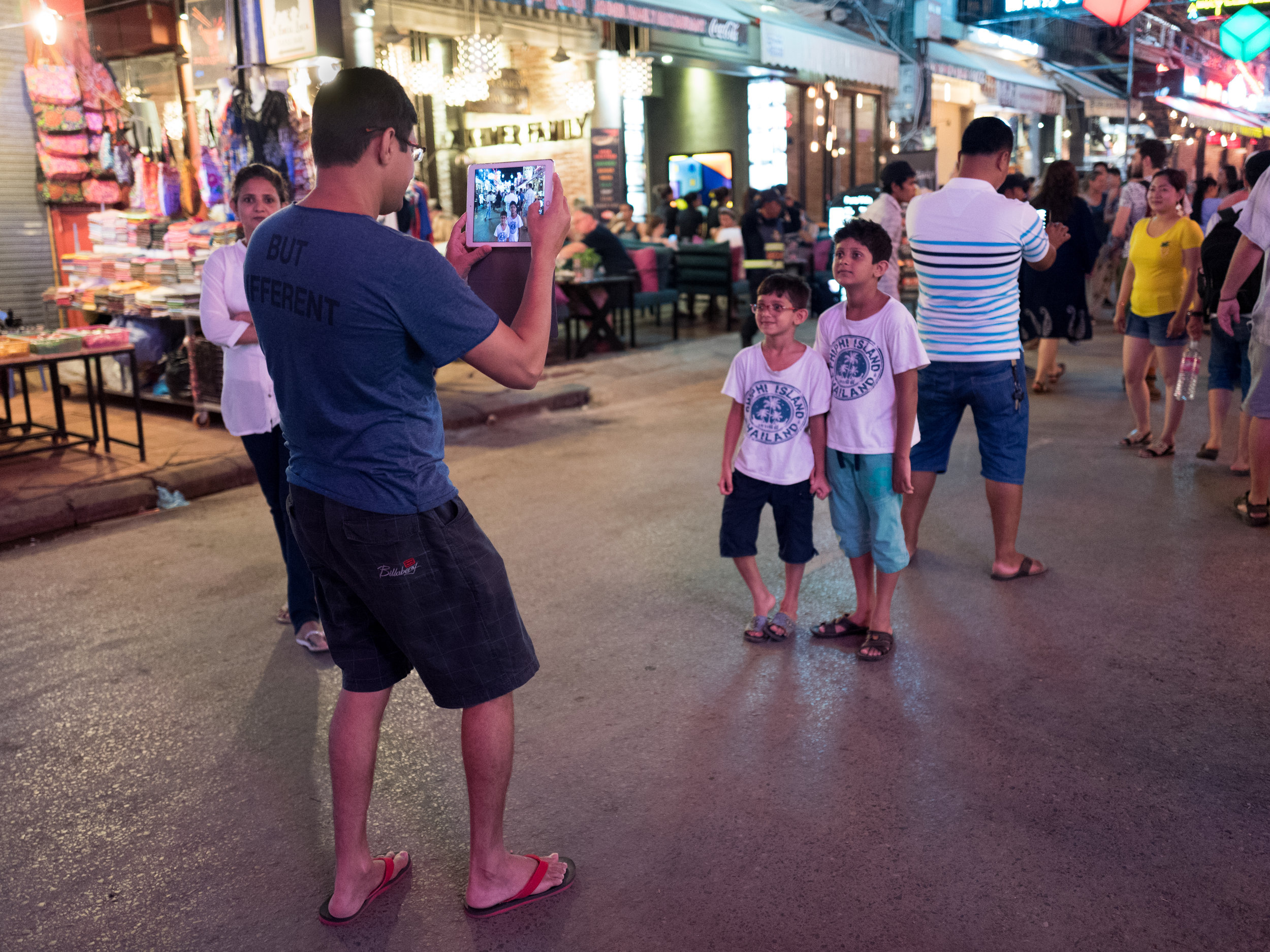 Siem Reap // Pub Street - The woman behind him knows what he's done.