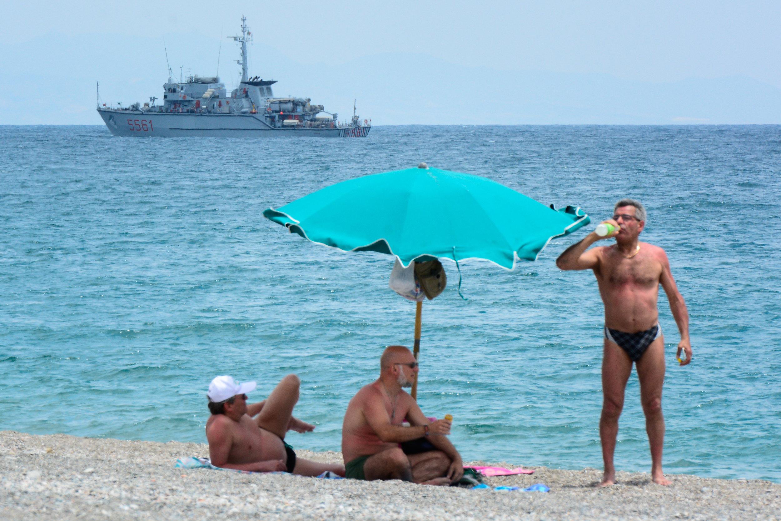 A Navy vessel patrols ahead the G7 summit in Giardini Naxos, Sicily, Italy, May 25, 2017.