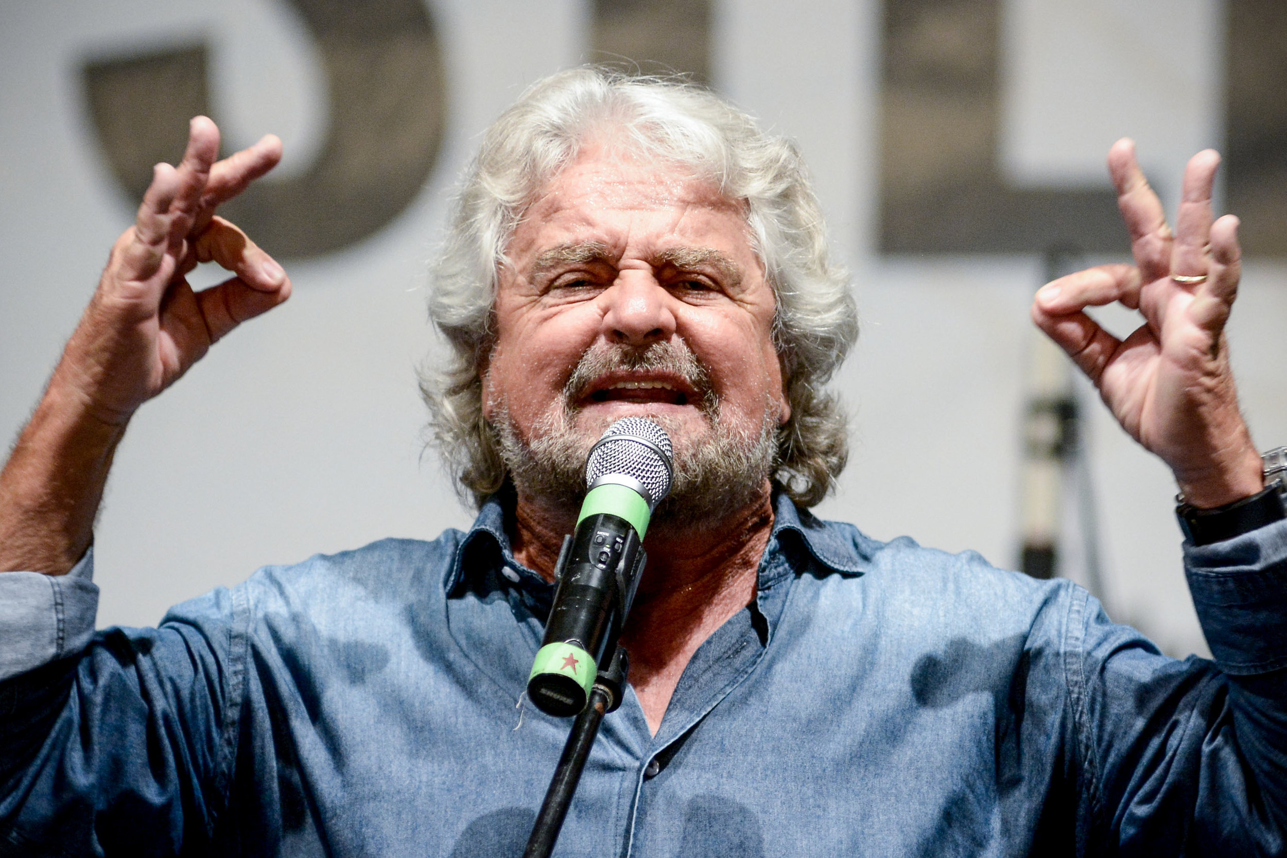 Founder of the 5-Star Movement Beppe Grillo gestures as he speaks during a rally in Palermo, southern Italy, September 24, 2016.