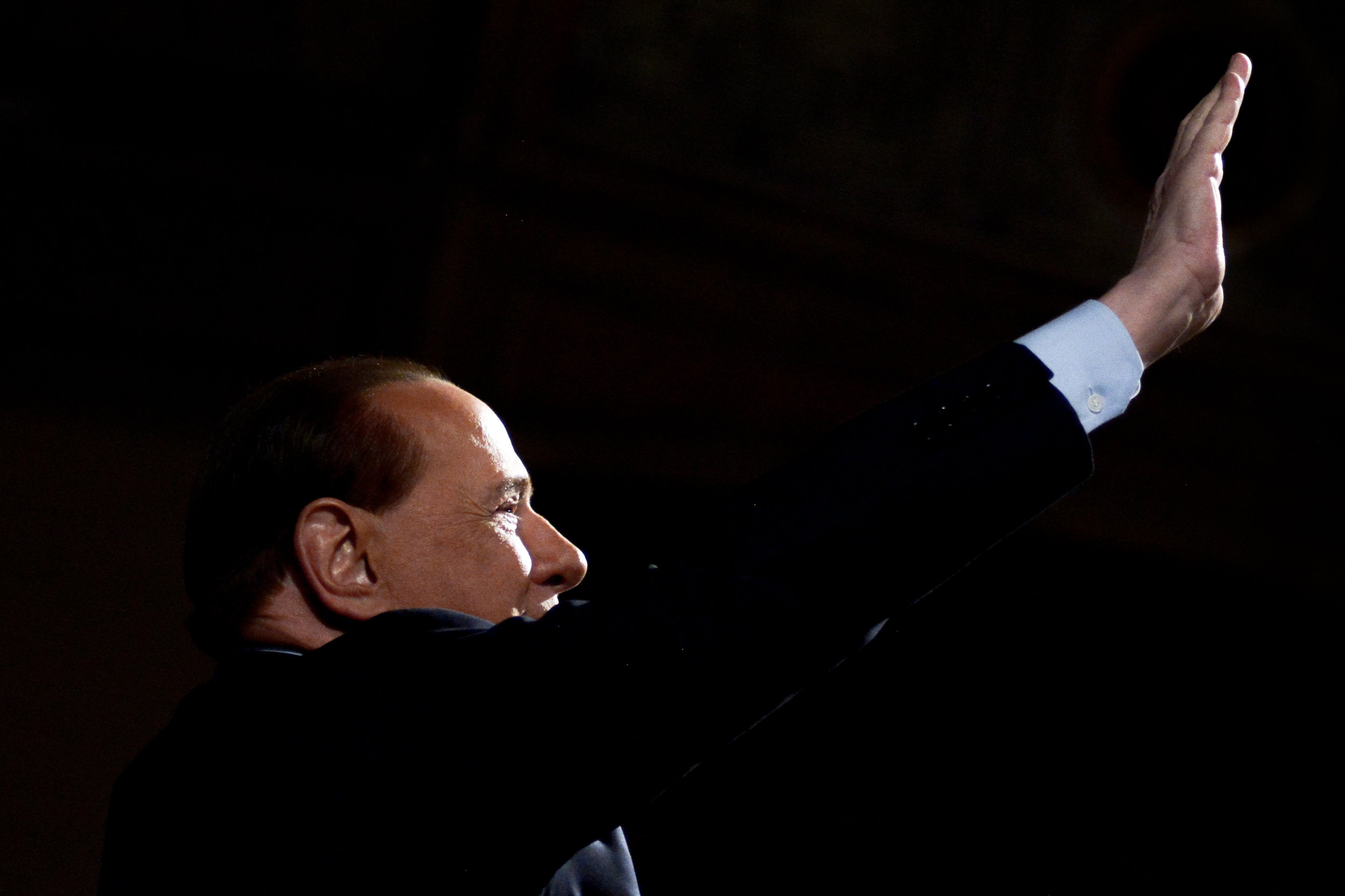 Forza Italia party leader Silvio Berlusconi waves to supporters after a rally in Palermo, Italy, March 19, 2016.