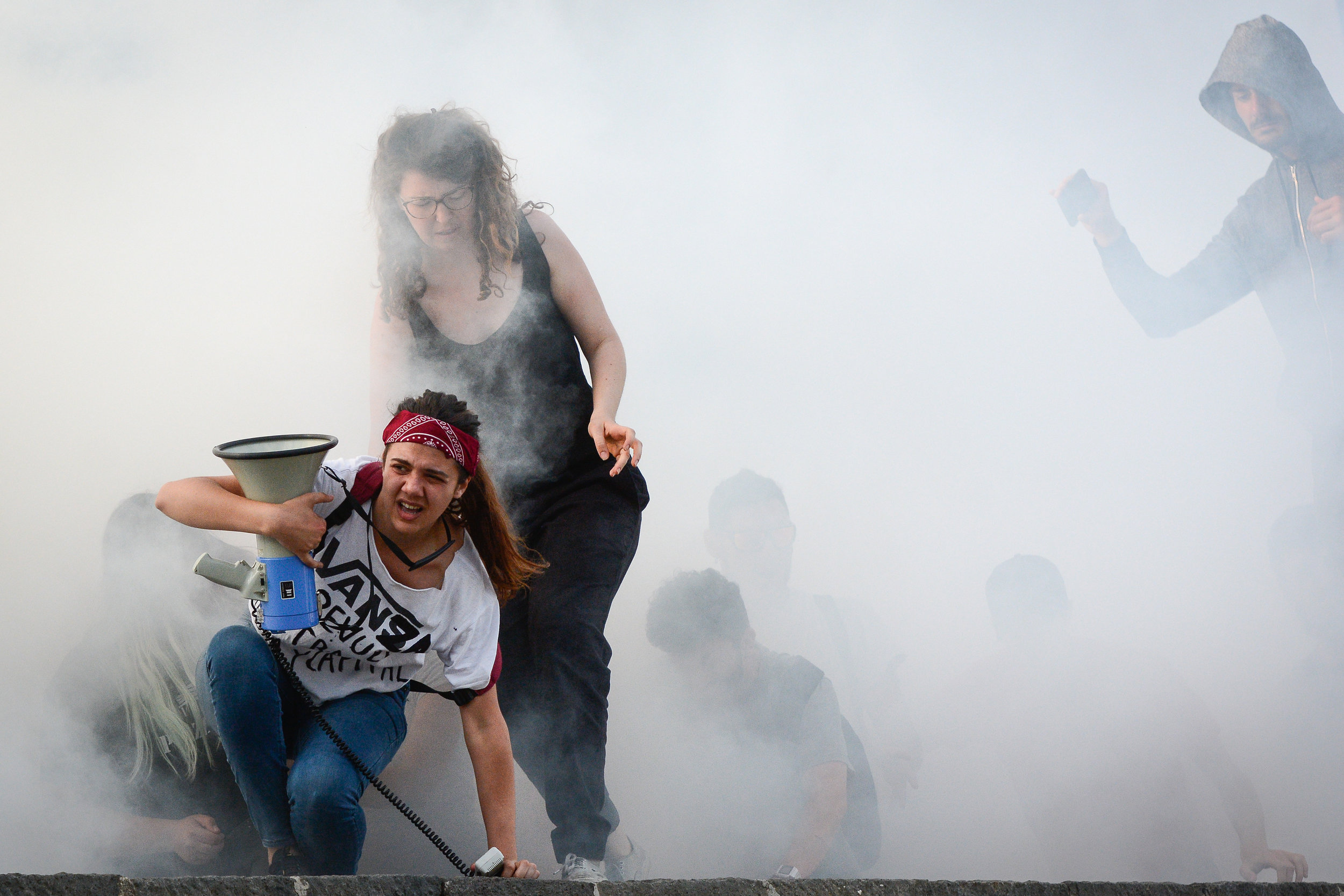 Demonstrators run away from tear gas during a demonstration against the G7 summit in Giardini Naxos, Italy, May 27, 2017.