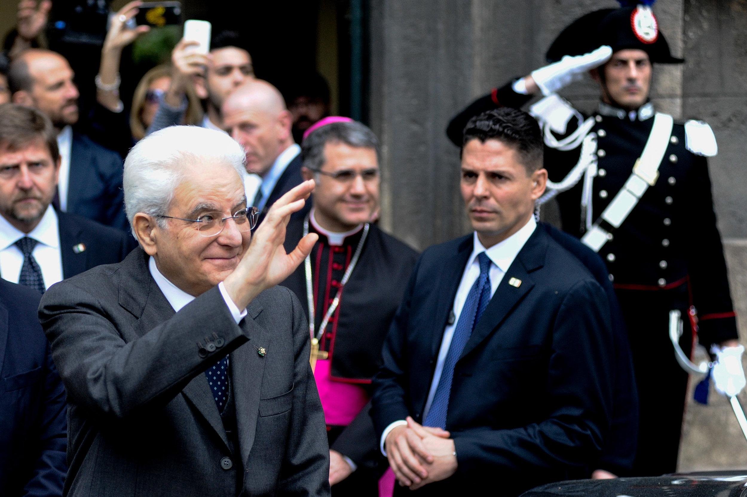Italian President Sergio Mattarella waves after attending the presentation of the book 'Sul cammino della verità' by former Cardinal of Palermo Salvatore Pappalardo, in Palermo, Italy, April 23, 2016.