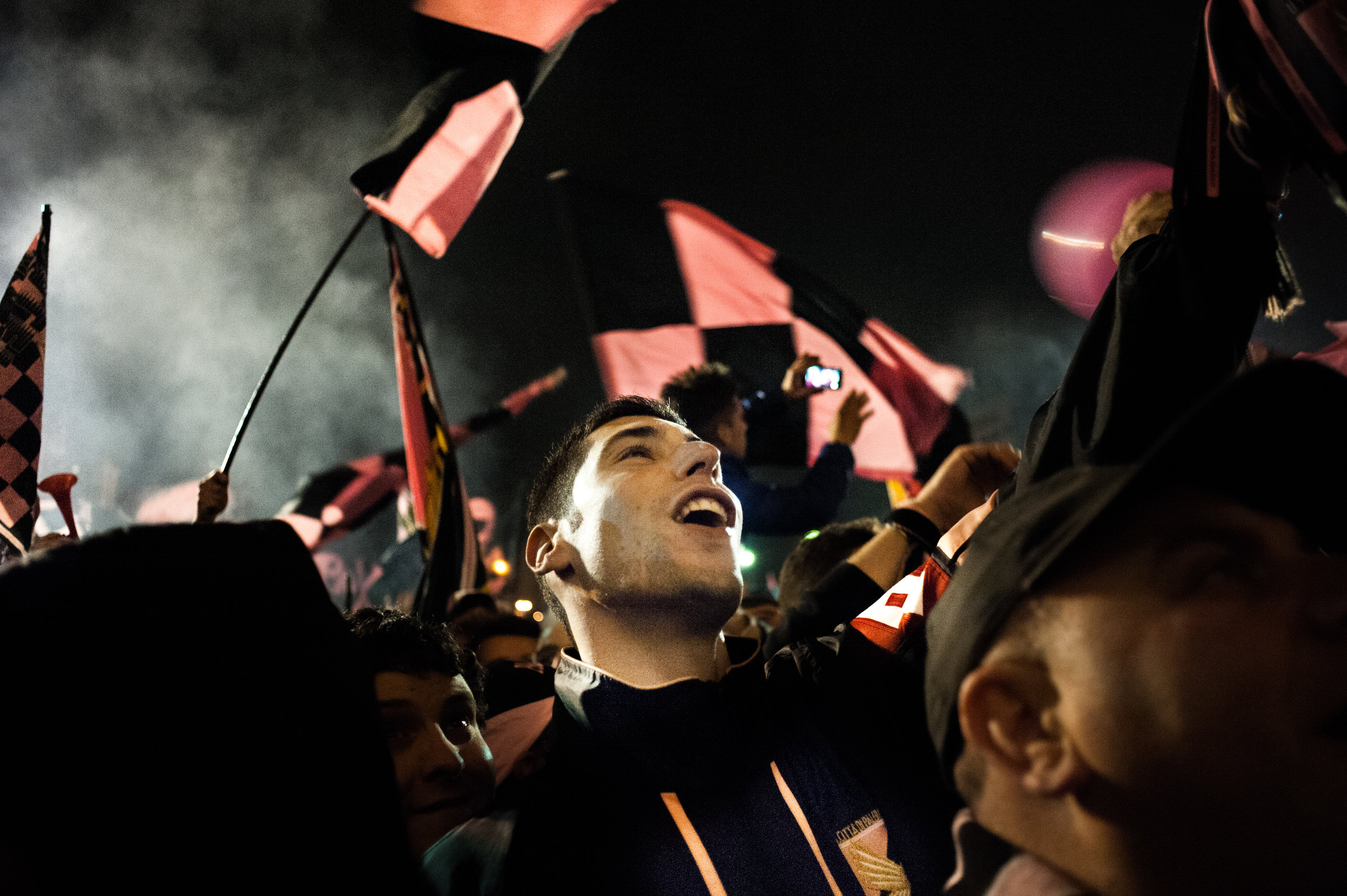 Fans celebrate outside the stadium Renzo Barbera as US Città di Palermo football team returns to Serie A after winning the game against Novara, in Palermo, Italy, May 3, 2014.
