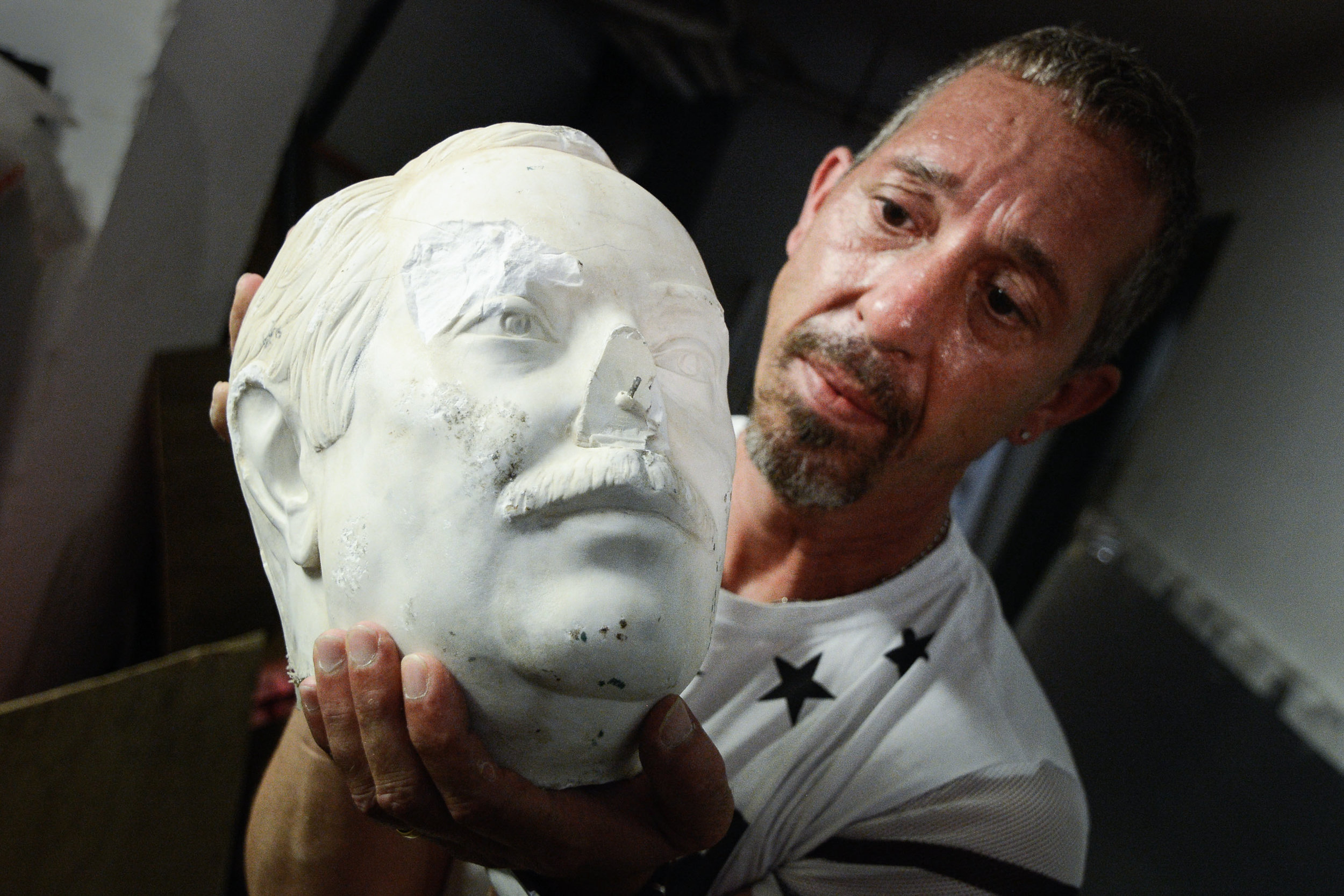 The head of vandalized statue of judge Giovanni Falcone is seen in Palermo, southern Italy, July 10, 2017.