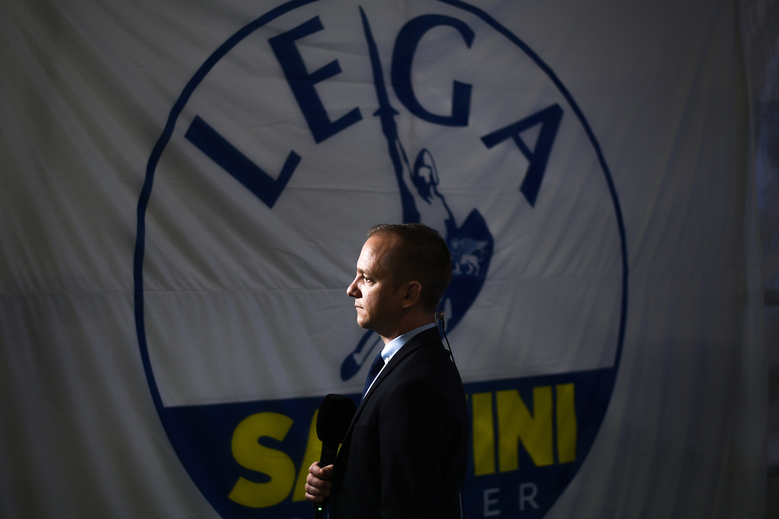 A journalist reports from the League party headquarters after the end of EU election voting, in Milan, Italy, May 26, 2019.