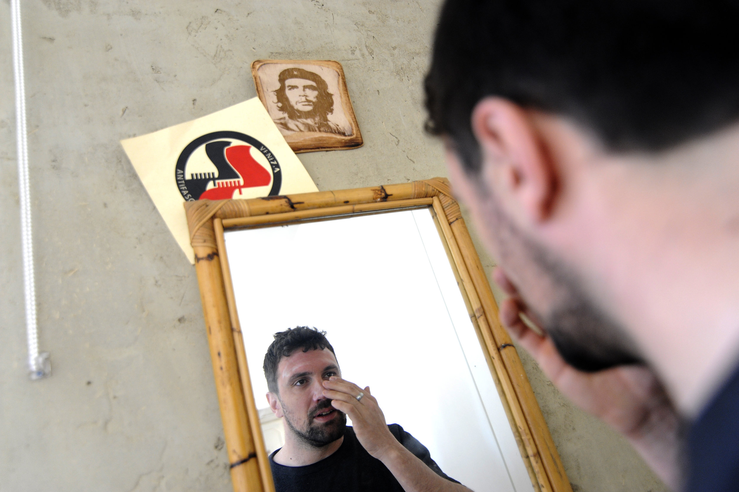 """Alessandro Dus, 34, gets ready to go to work in his illegally occupied apartment in the Casette neighbourhood in Venice, Italy, April 3, 2019. """"The choice to live in an illegally occupied apartment is an economic but also political choice. We want to denounce the thousands of closed abandoned apartments in Venice and when we move to an abandoned apartment we renovate it and we make it habitable again."""", Dus said."""