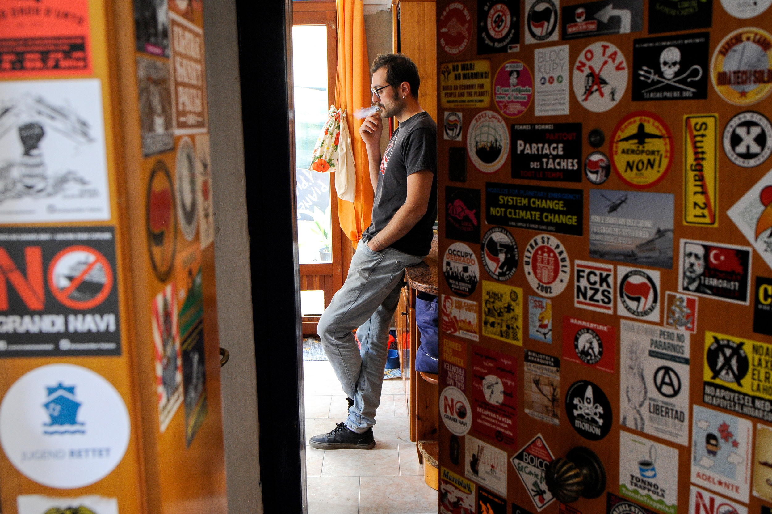 """Pasquale Ambrogio, 33, smokes a cigarette in his illegally occupied apartment in the Casette neighbourhood in Venice, Italy, April 3, 2019. """"I moved to this apartment 7 years ago. I can't afford to pay a rent in Venice but I don't want to leave the city. I consider myself a resisting citizen"""", Ambrogio said."""