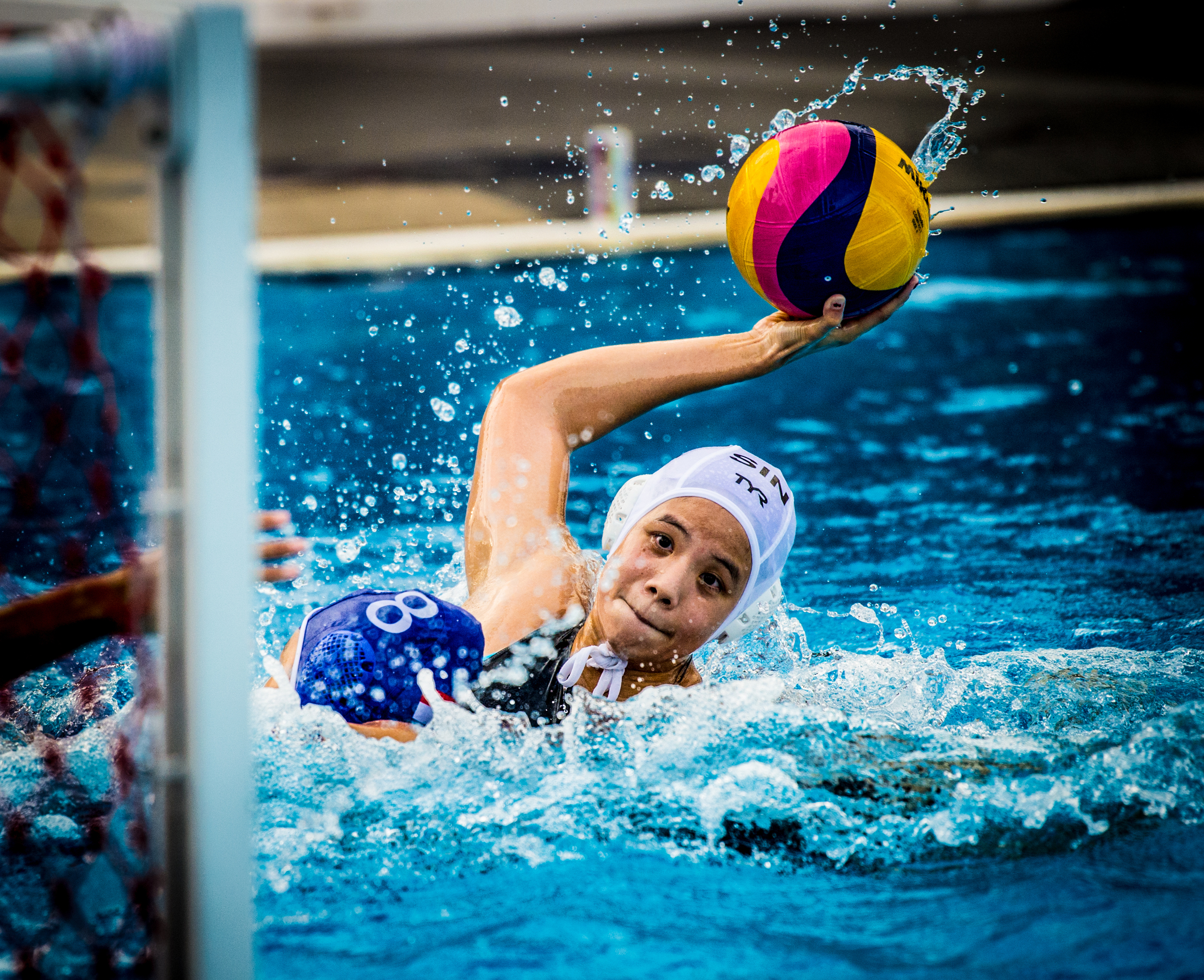 A Singaporean player prepares to take a shot during a match at the Toa Payoh Swimming Complex.