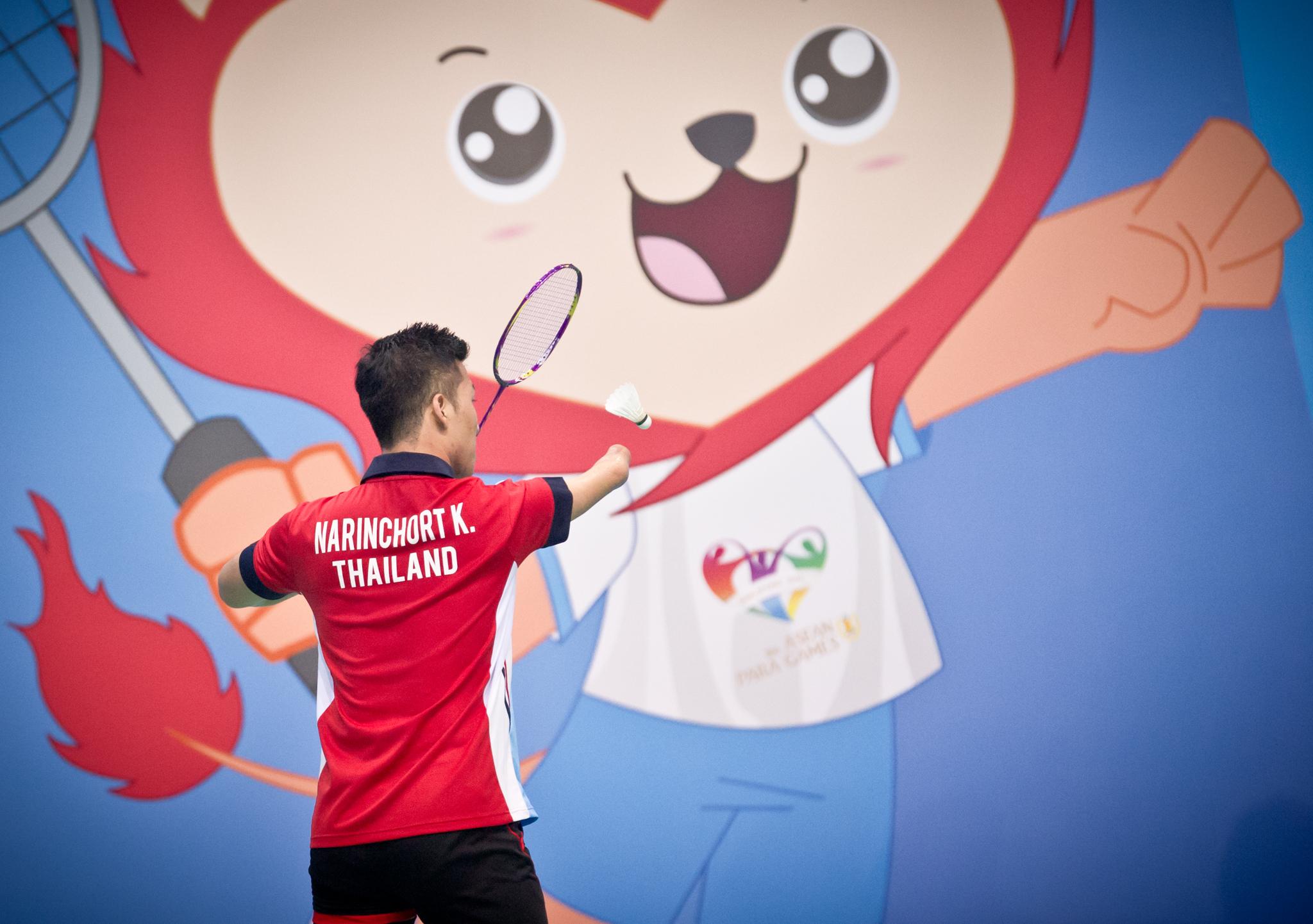 A Thai para-badminton player serves during the ASEAN Para Games at the OCBC Arena.