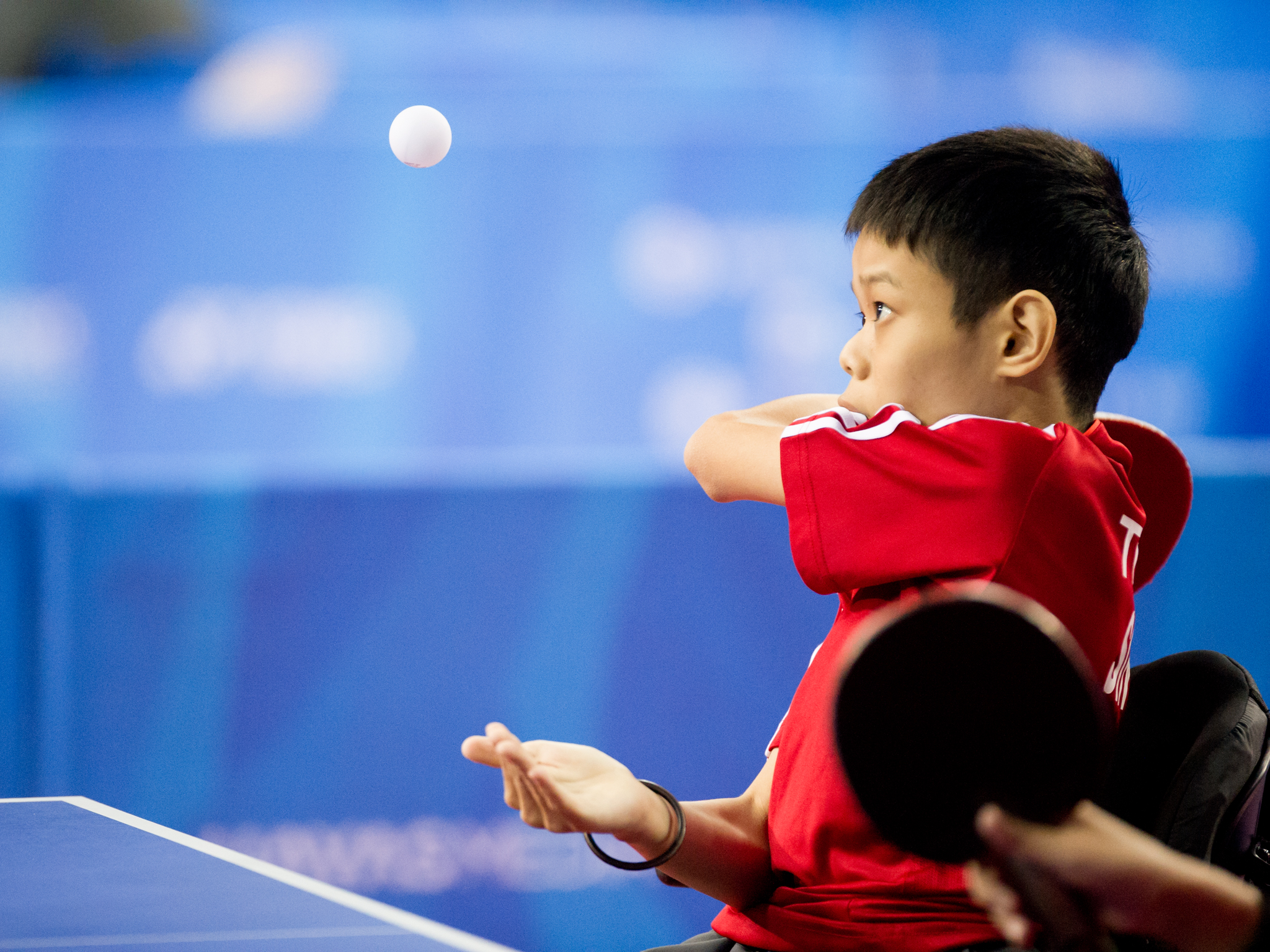 A para-table tennis player serves during the ASEAN Para Games at the OCBC Arena.