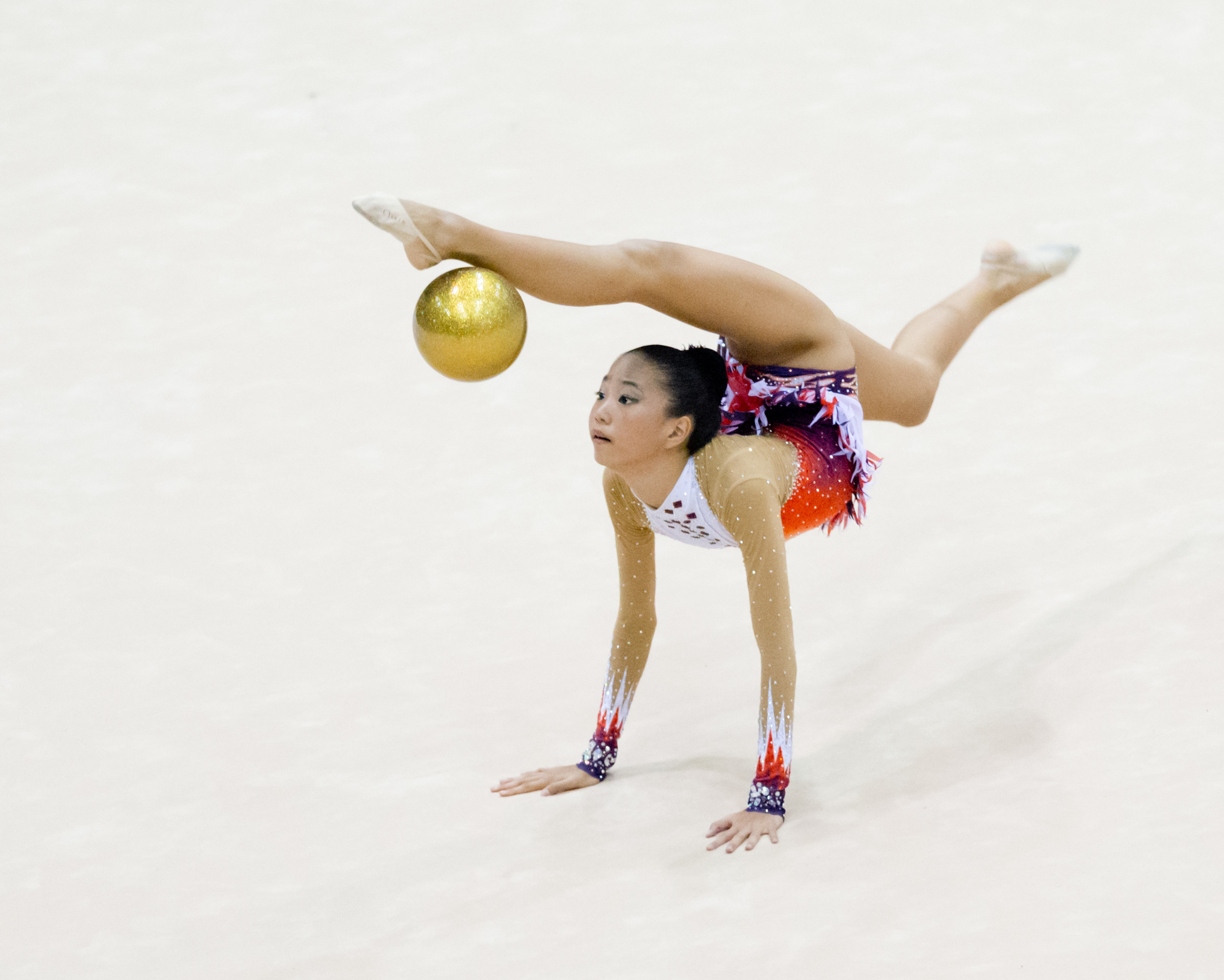 A gymnast bounces her ball during the Singapore Open at the Bishan Sports Hall.