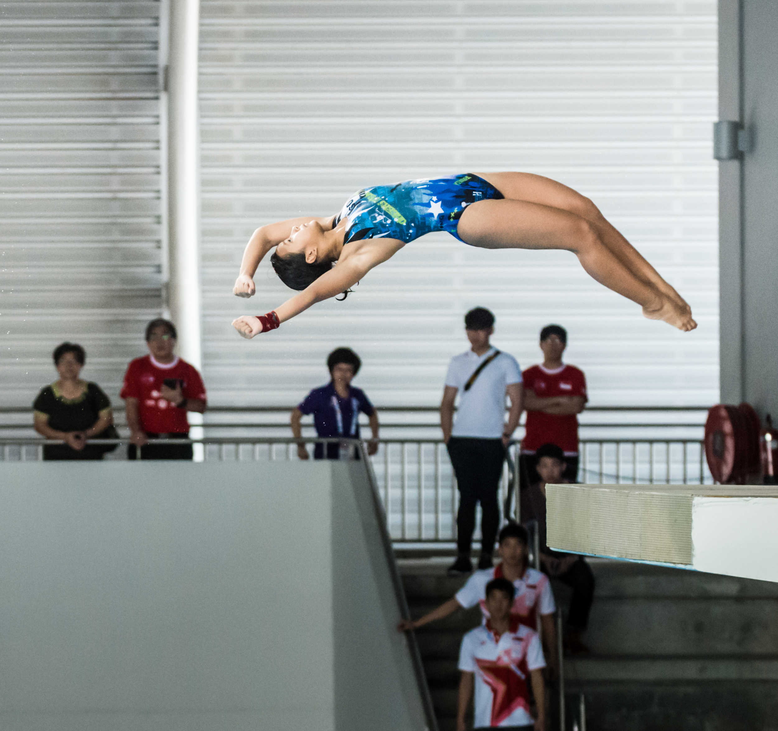 A Malaysian diver jumps off the 10m platform during the SEA Games at the OCBC Aquatic Centre.