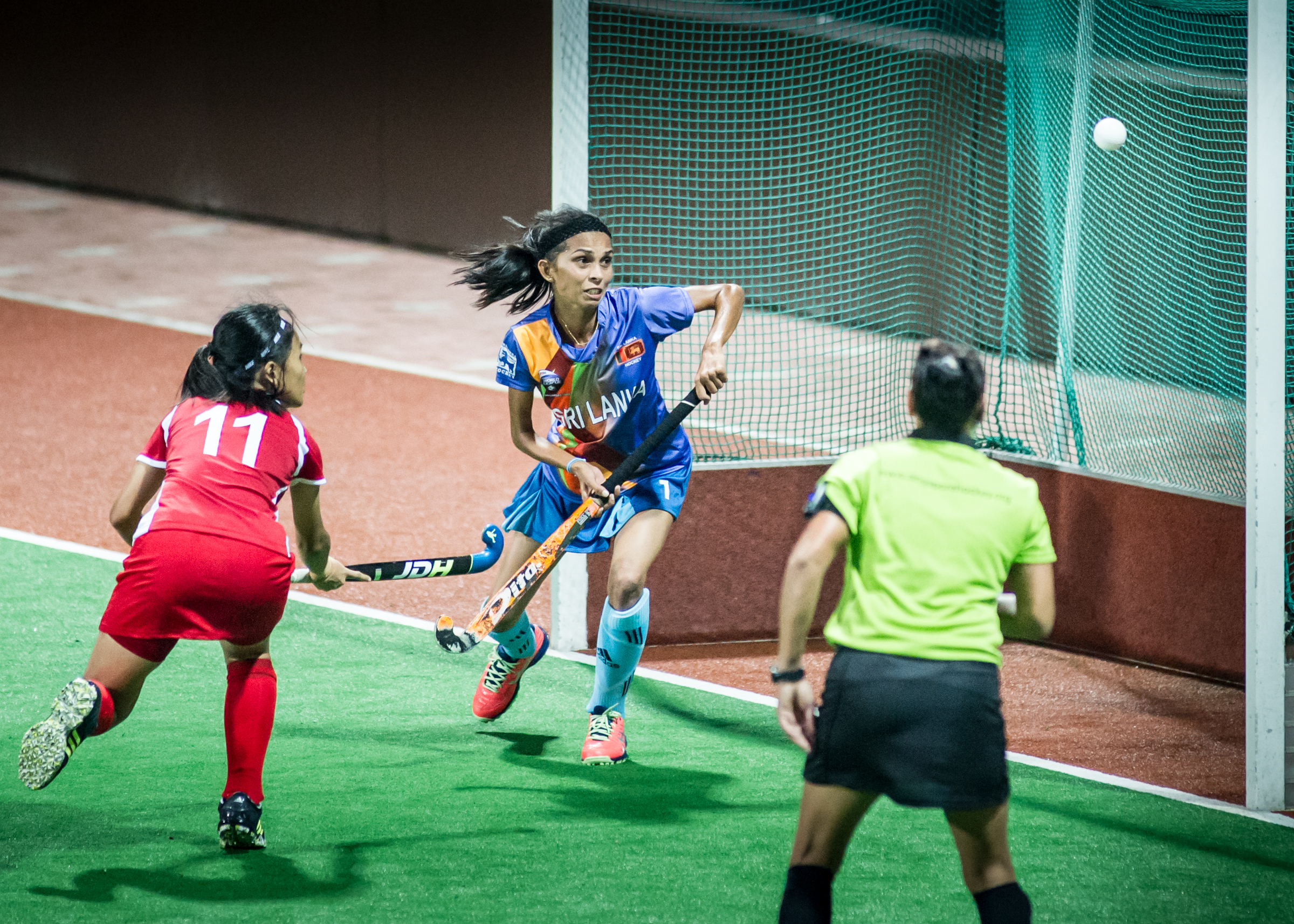 A Singaporean player scores against Sri Lanka during a World Hockey League match at the Sengkang Sports Complex.