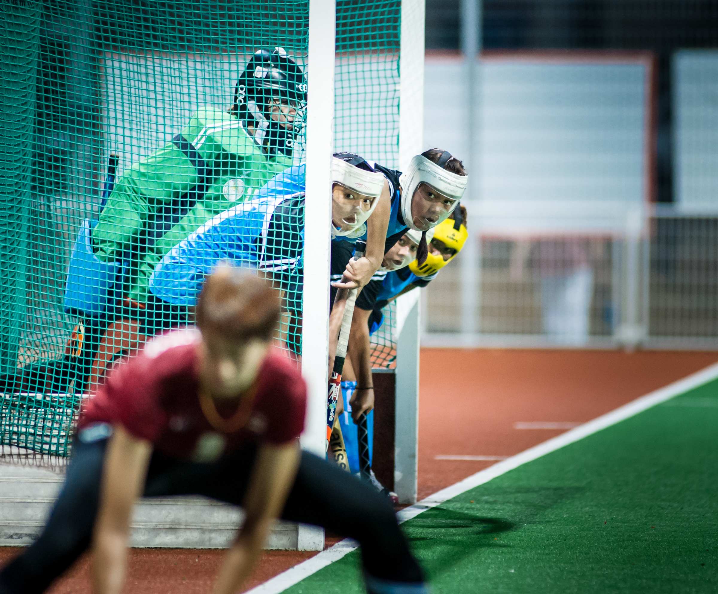 Cambodian players watch as a Thai player prepares to take a corner penalty during a World Hockey League match at the Sengkang Sports Complex.