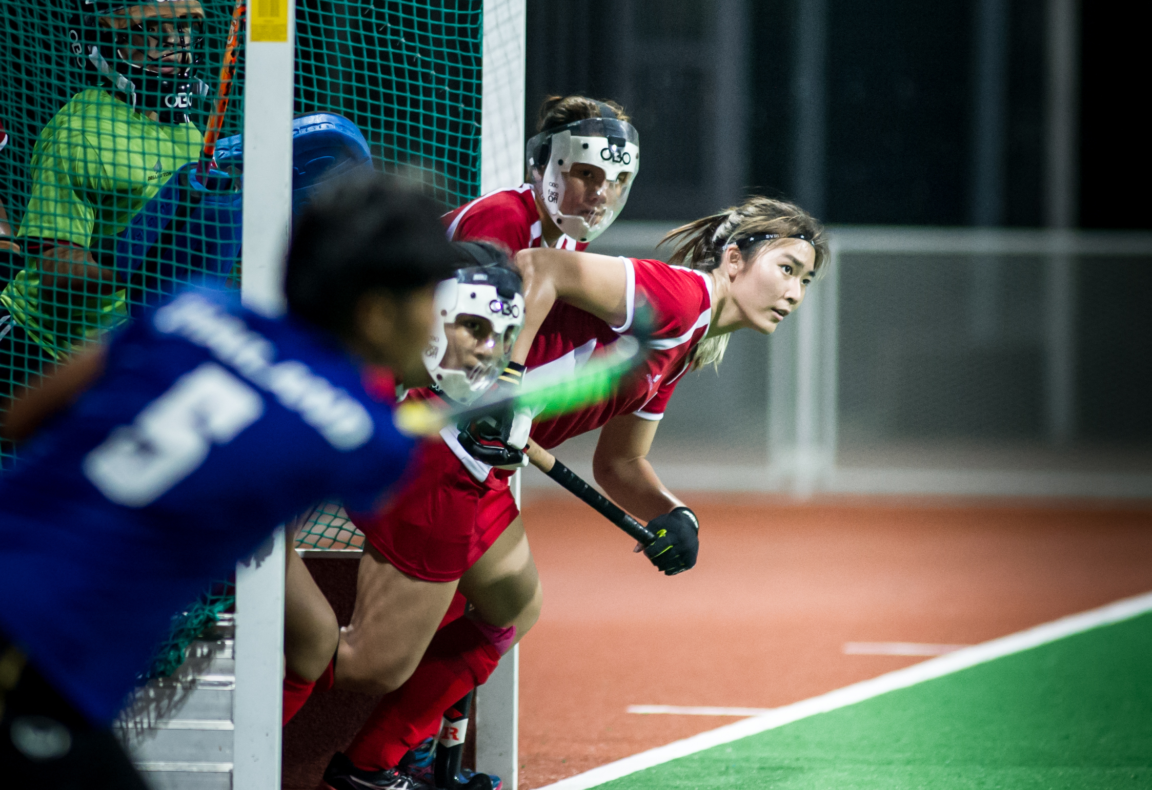 A Singaporean player rushes out of the goal as a Thai player takes a corner penalty during a World Hockey League match at the Sengkang Sports Complex.
