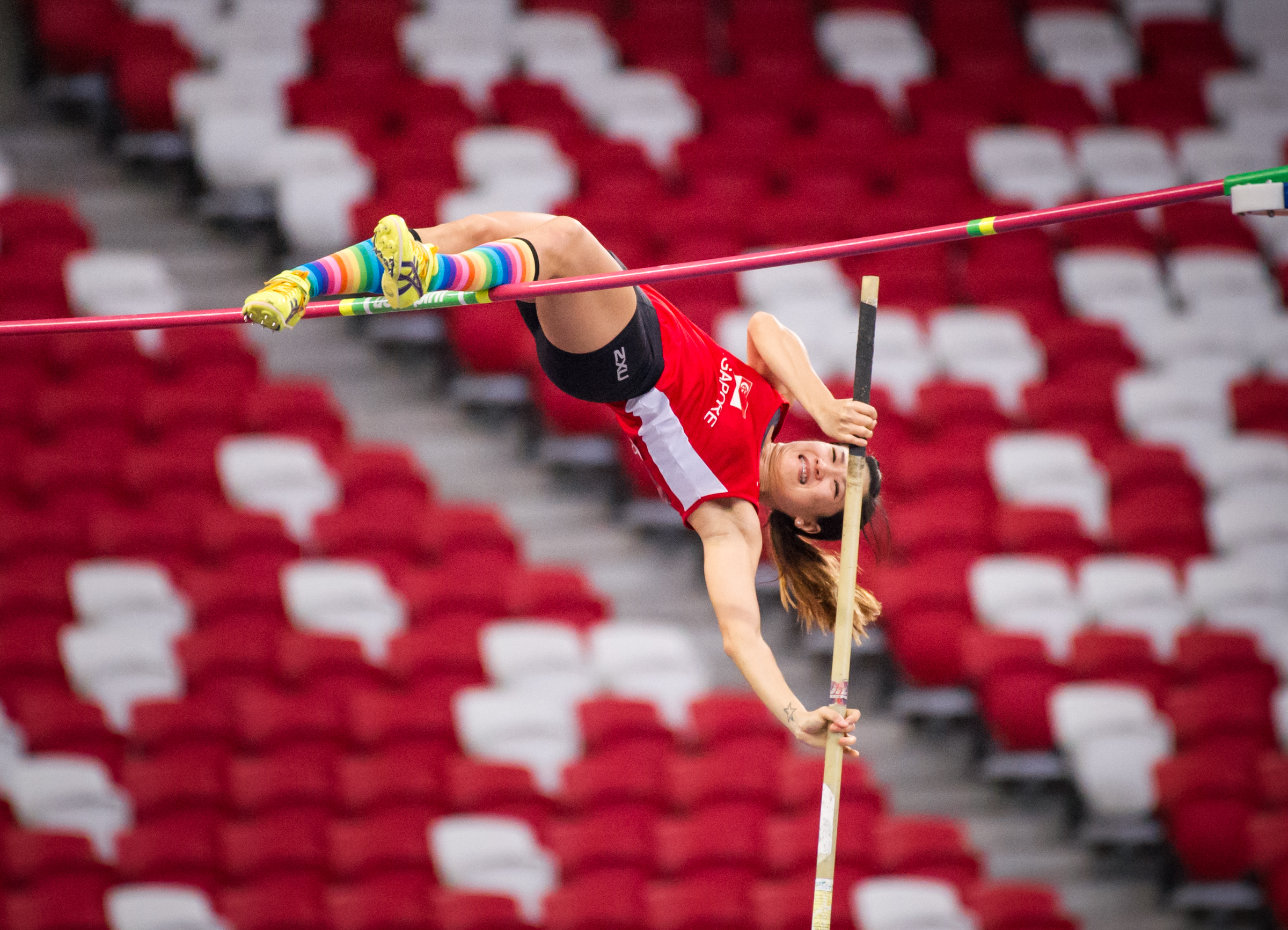 A Singaporean Pole Vaulter prepares to fly over the bar during the Singapore Open Track and Field Championships held at the Singapore Sports Hub.