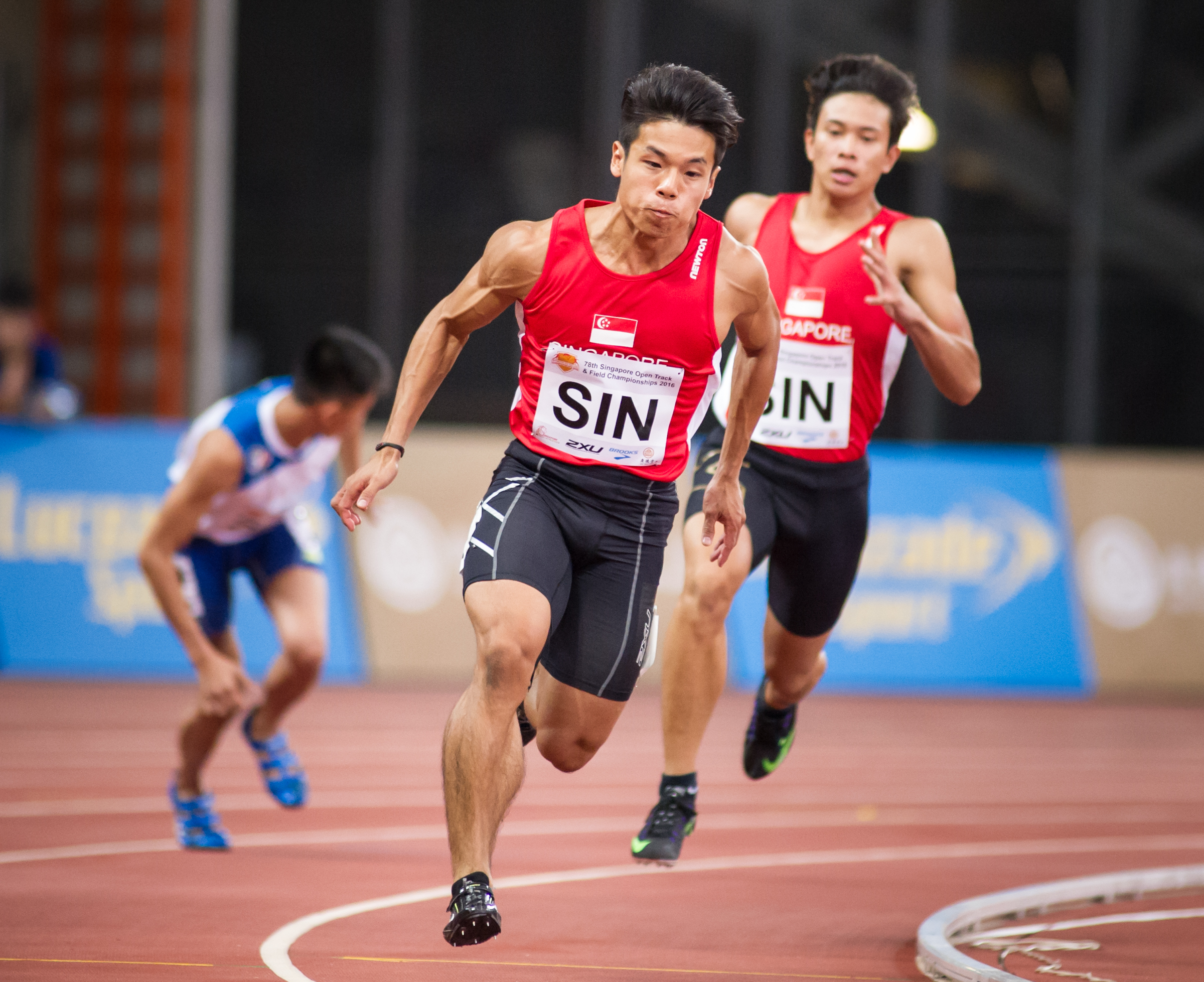 A Singaporean runner prepares to receive the baton during the Singapore Open Track and Field Championships held at the Singapore Sports Hub.