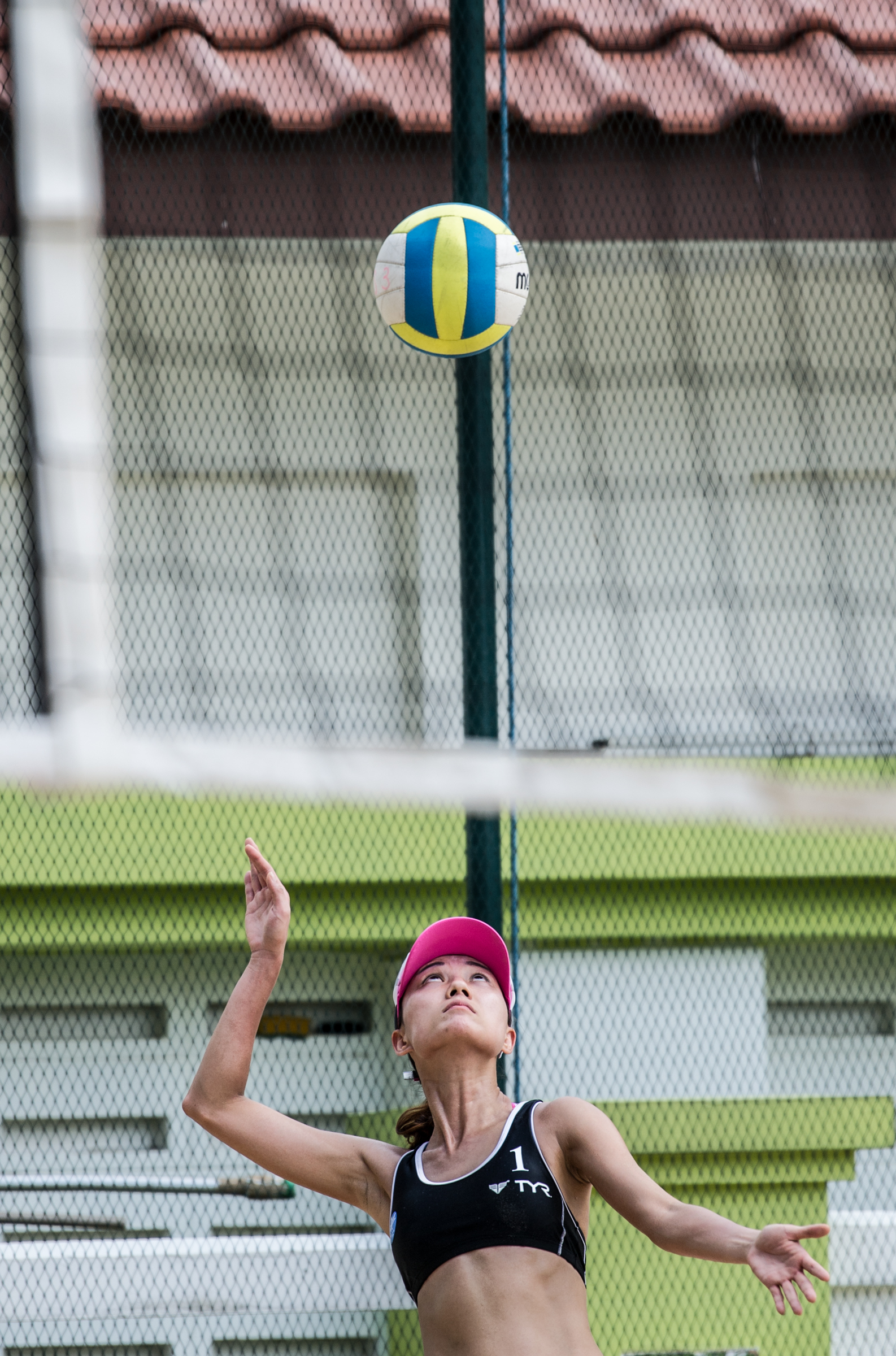 A Hong Kong player prepares to serve during the Beach Volleyball National Series at the Yio Chu Kang Swimming Complex.